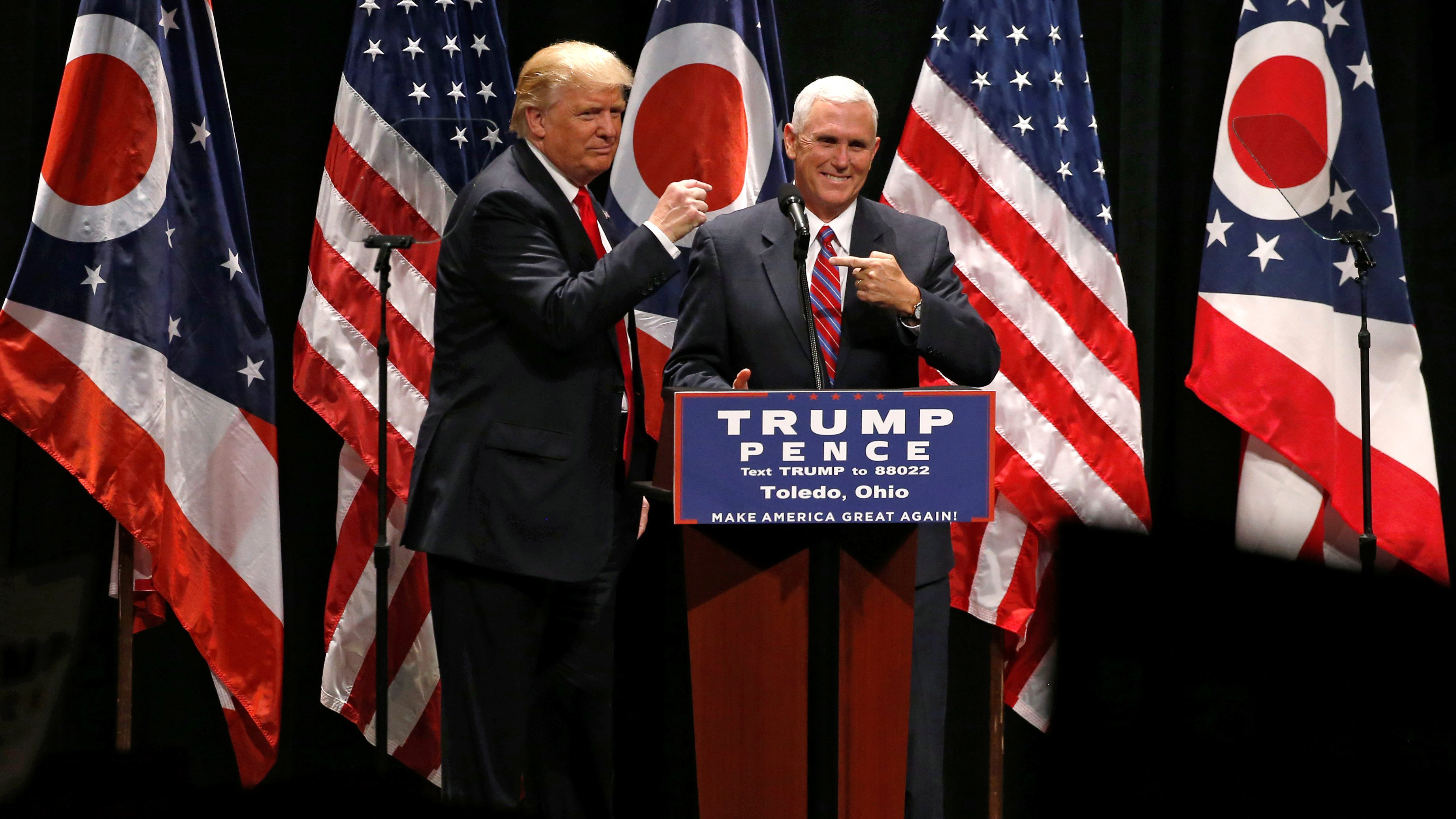 Republican presidential nominee Donald Trump brings vice presidential nominee Mike Pence onstage as he rallies with supporters in Toledo, Ohio.
