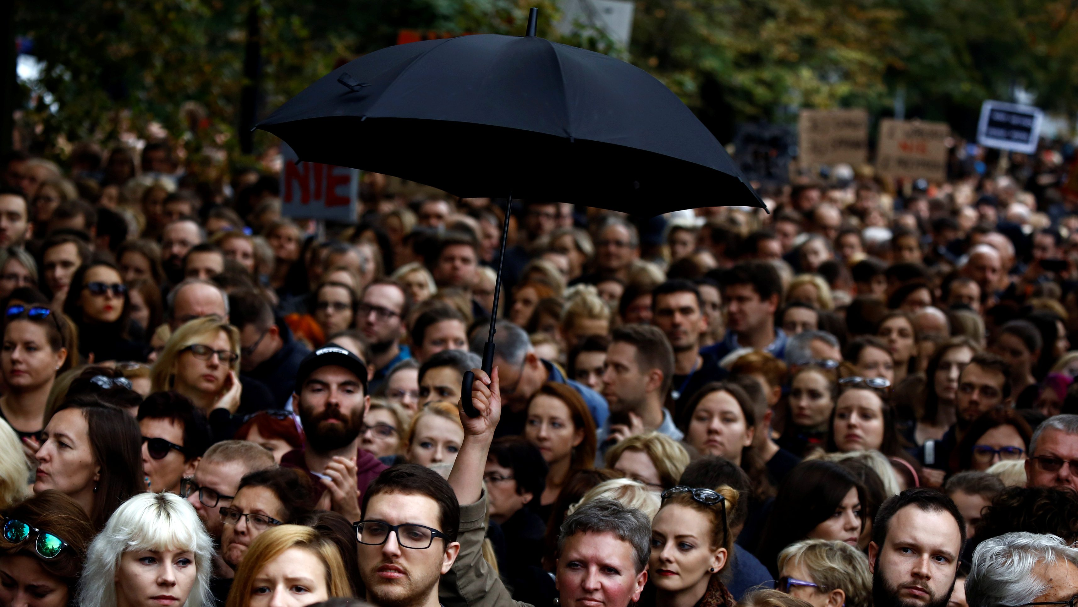 """People gather as they take part in an abortion rights campaigners' demonstration """"Black Protest"""" in front of the Parliament in Warsaw, Poland October 1, 2016. REUTERS/Kacper Pempel - RTSQBXE"""
