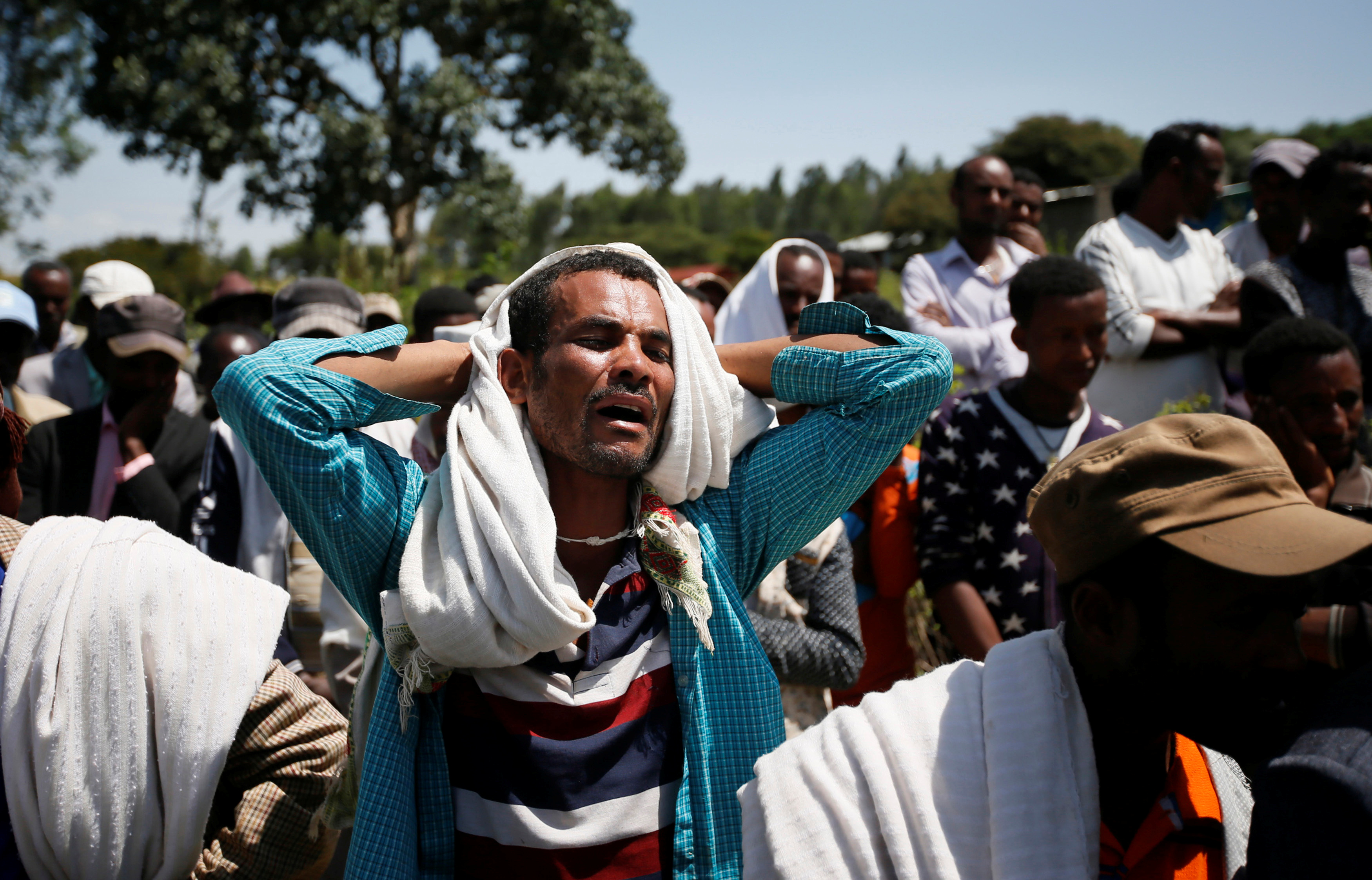 A man mourns during the funeral of Tesfu Tadese Biru, a construction engineer who died during a stampede after police fired warning shots at an anti-government protest in Bishoftu during Irreecha in Denkaka Kebele