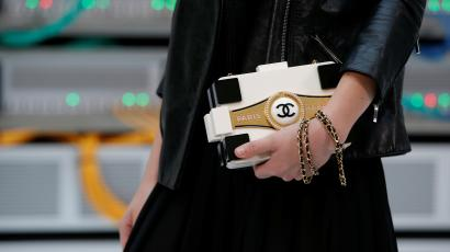 The Chanel logo is seen on a handbag before the Spring/Summer 2017 women's ready-to-wear collection for fashion house Chanel during Fashion Week in Paris, France October 4, 2016. REUTERS/Gonzalo Fuentes