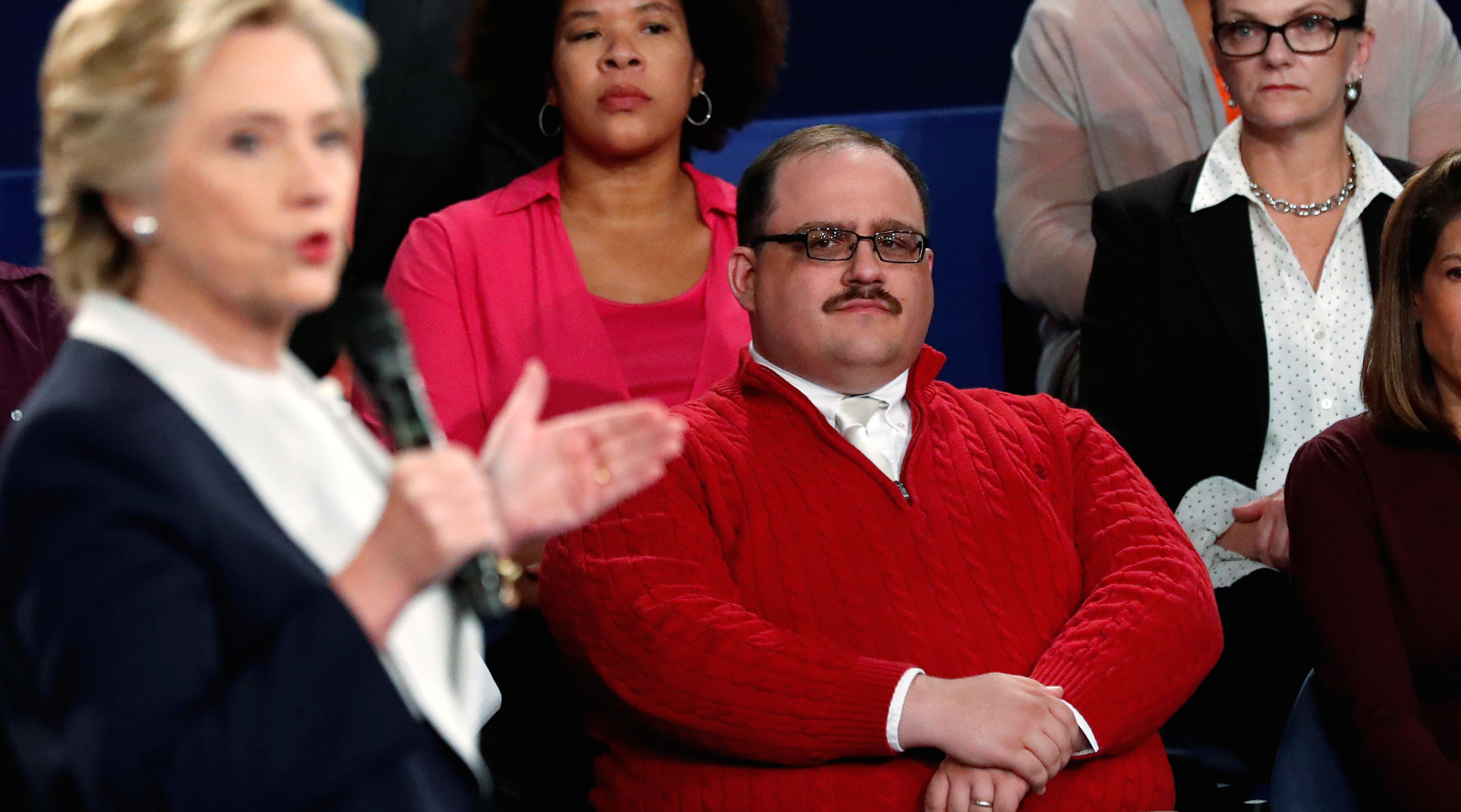 Ken Bone (R), an uncommitted voter who is a power plant employee from Belleville, Illinois, listens to Democratic nominee Hillary Clinton (L) during her presidential debate with Republican U.S. presidential nominee Donald Trump at Washington University in St. Louis, Missouri, U.S., October 9, 2016. Picture taken October 9, 2016.