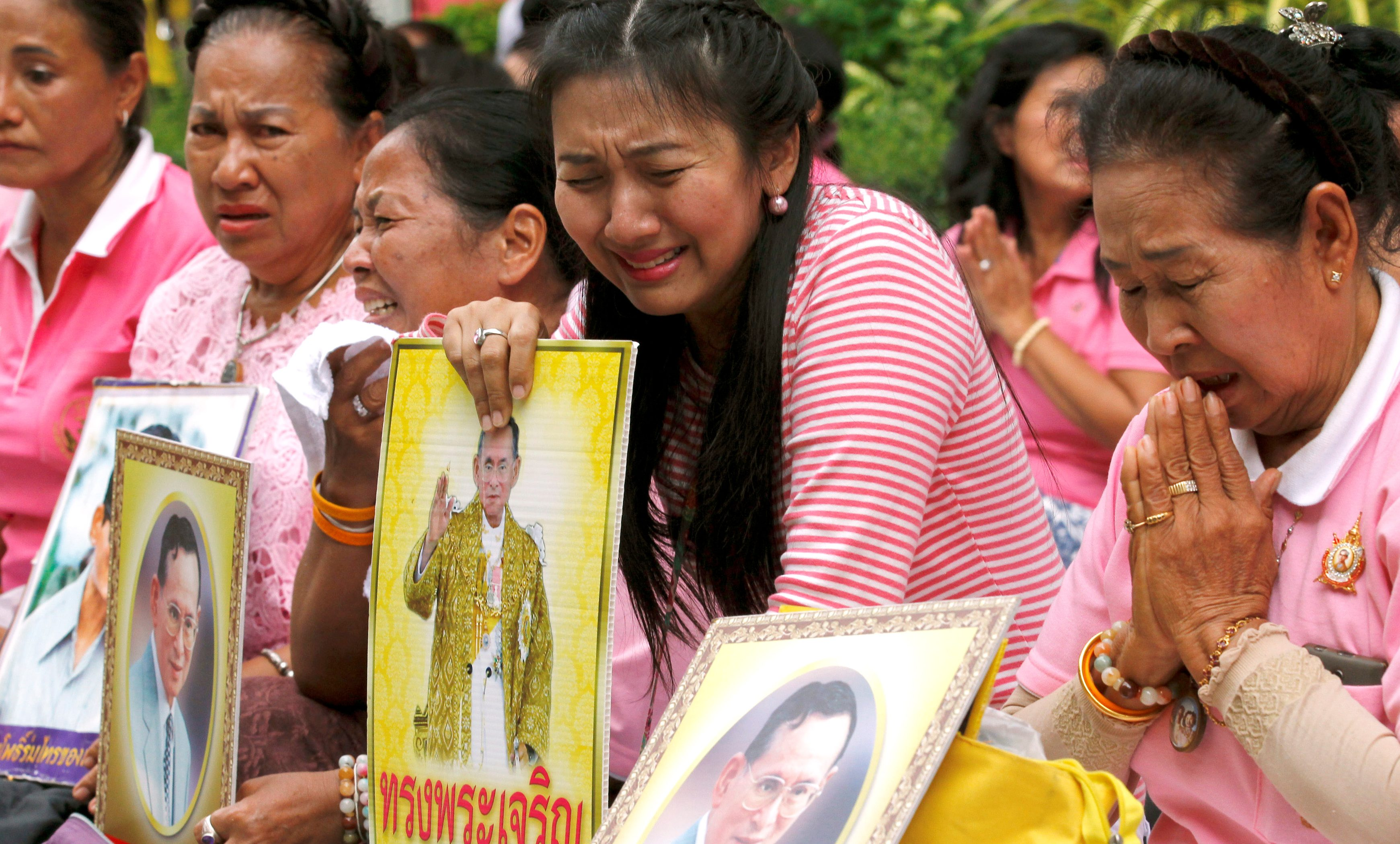 Well-wishers weep as they prays for Thailand's King Bhumibol Adulyadej at the Siriraj hospital where he is residing in Bangkok, Thailand, October 13, 2016.