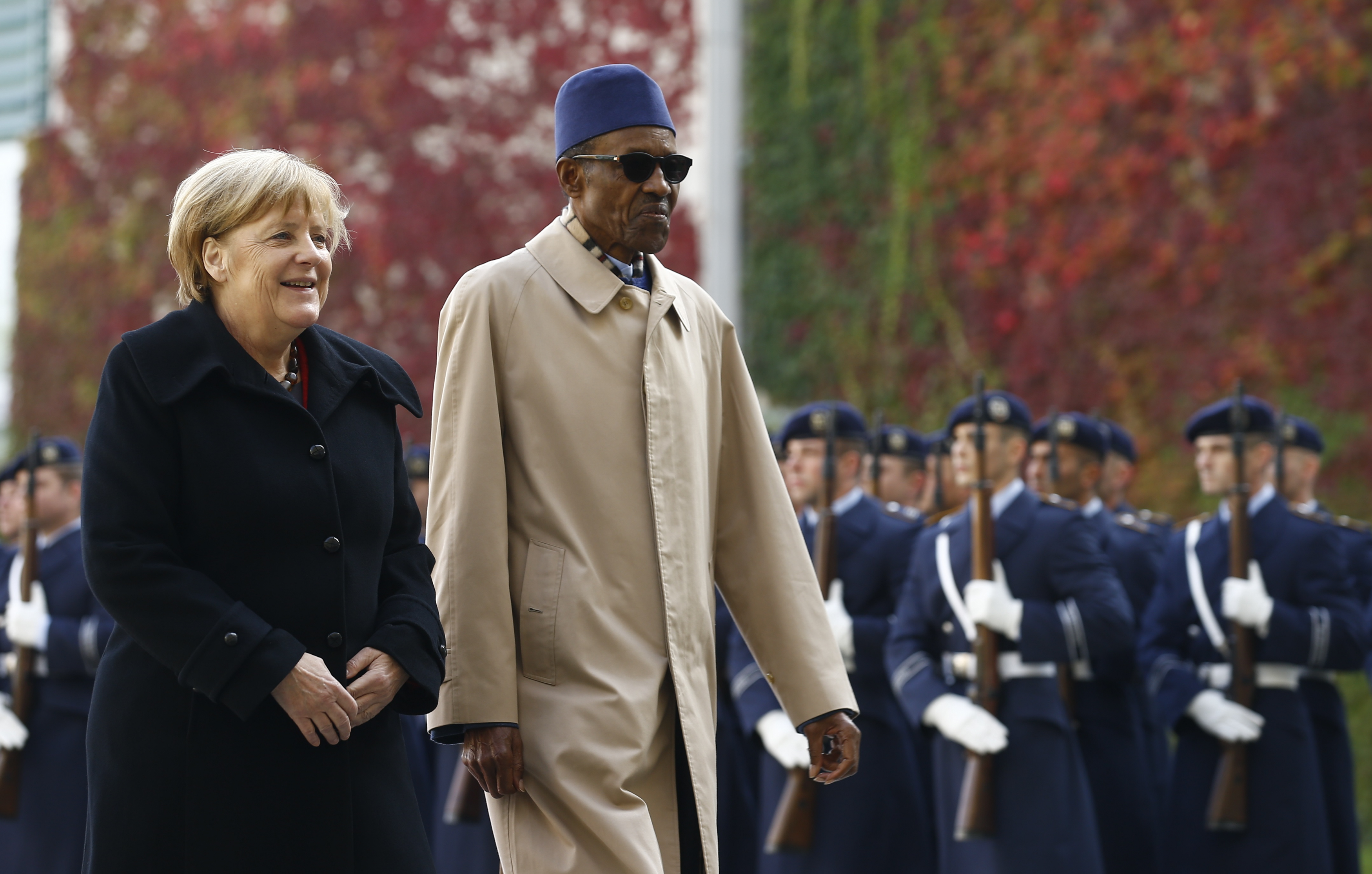 German Chancellor Merkel and Nigerian President Buhari review the honour guard during a welcoming ceremony at the chancellery in Berlin