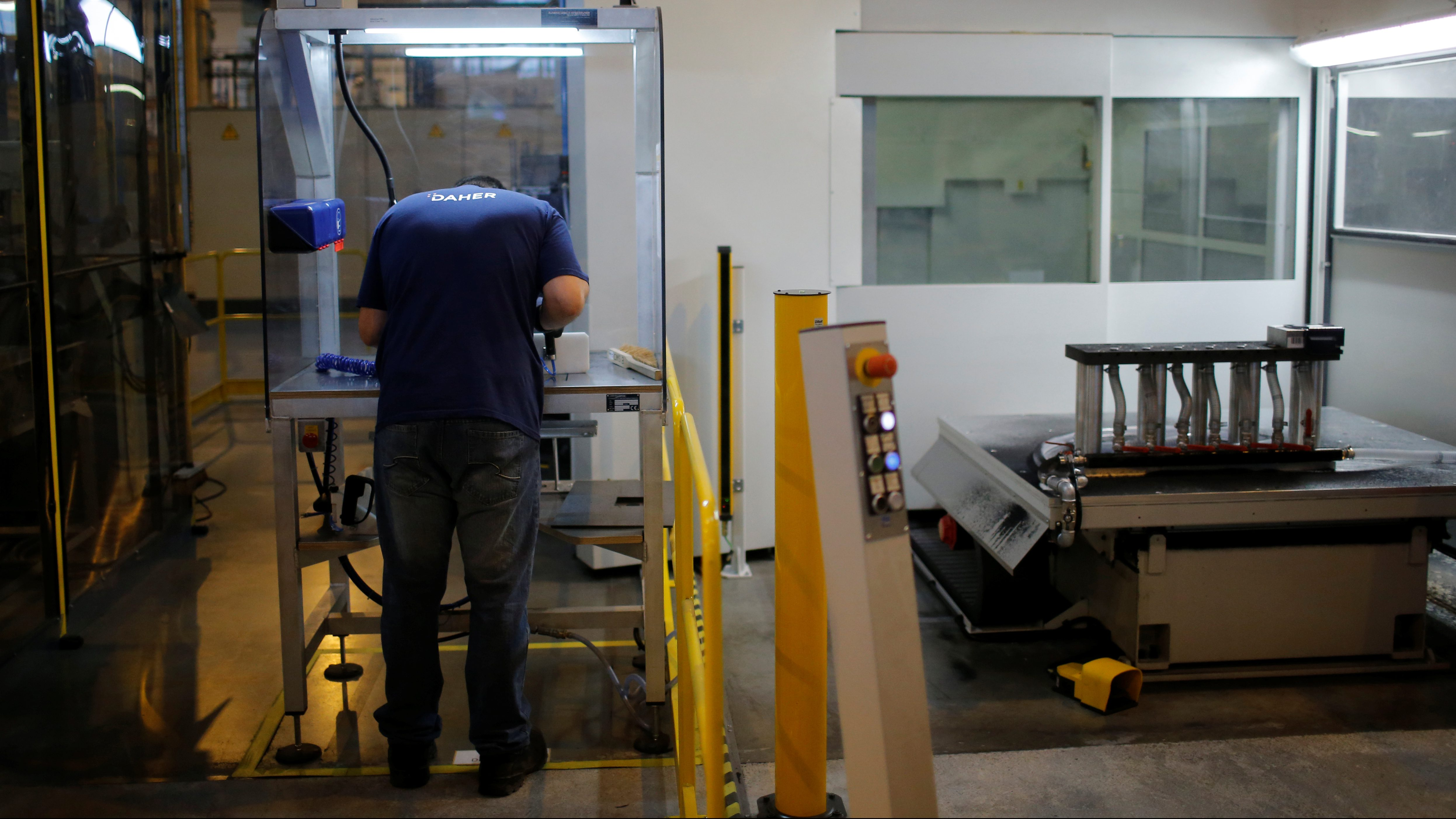 An employee works in the aerospace equipment maker Daher plant in Saint-Aignan-Grandlieu near Nantes