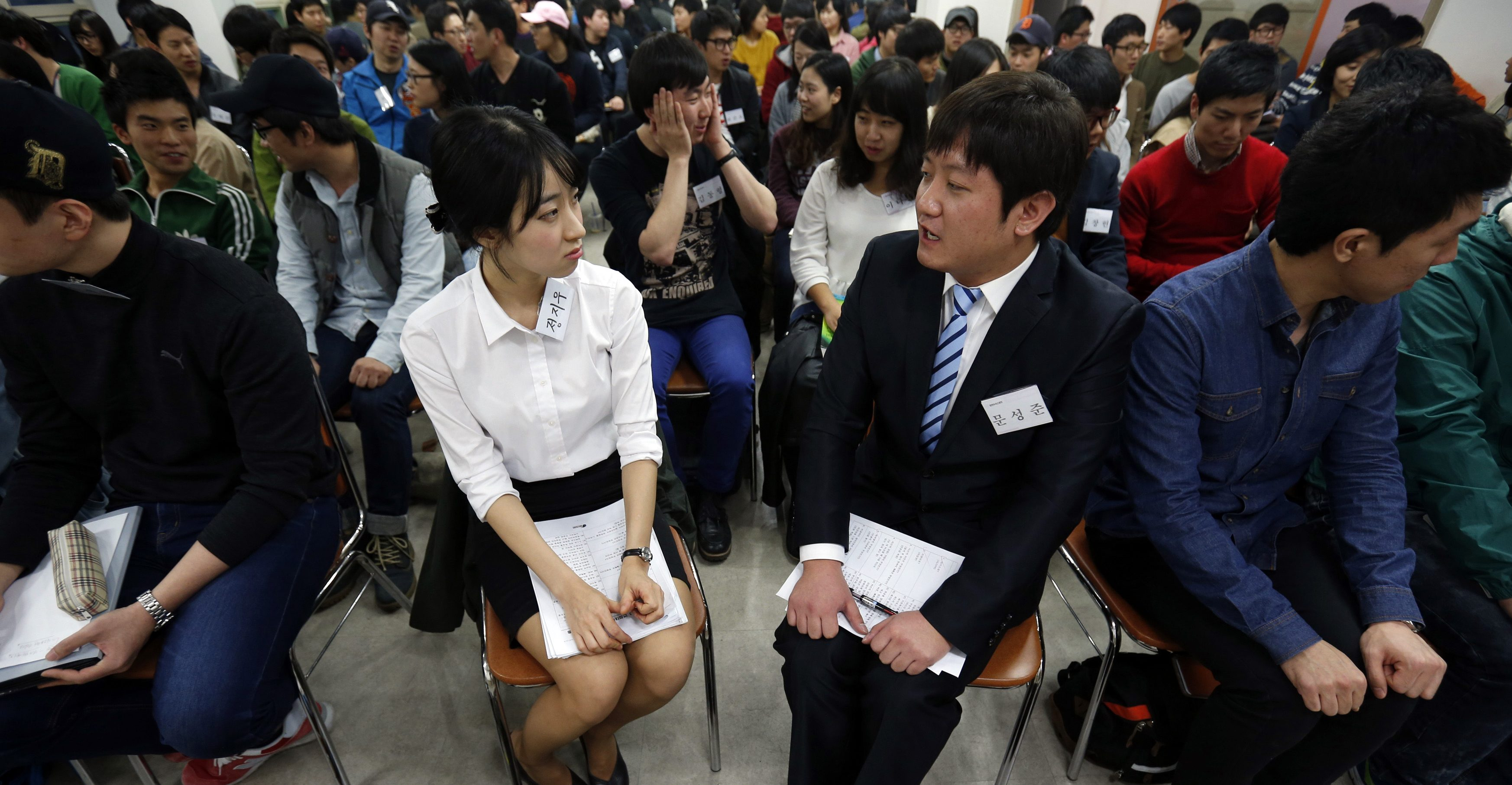 College students attend a class at a private cram school in Busan