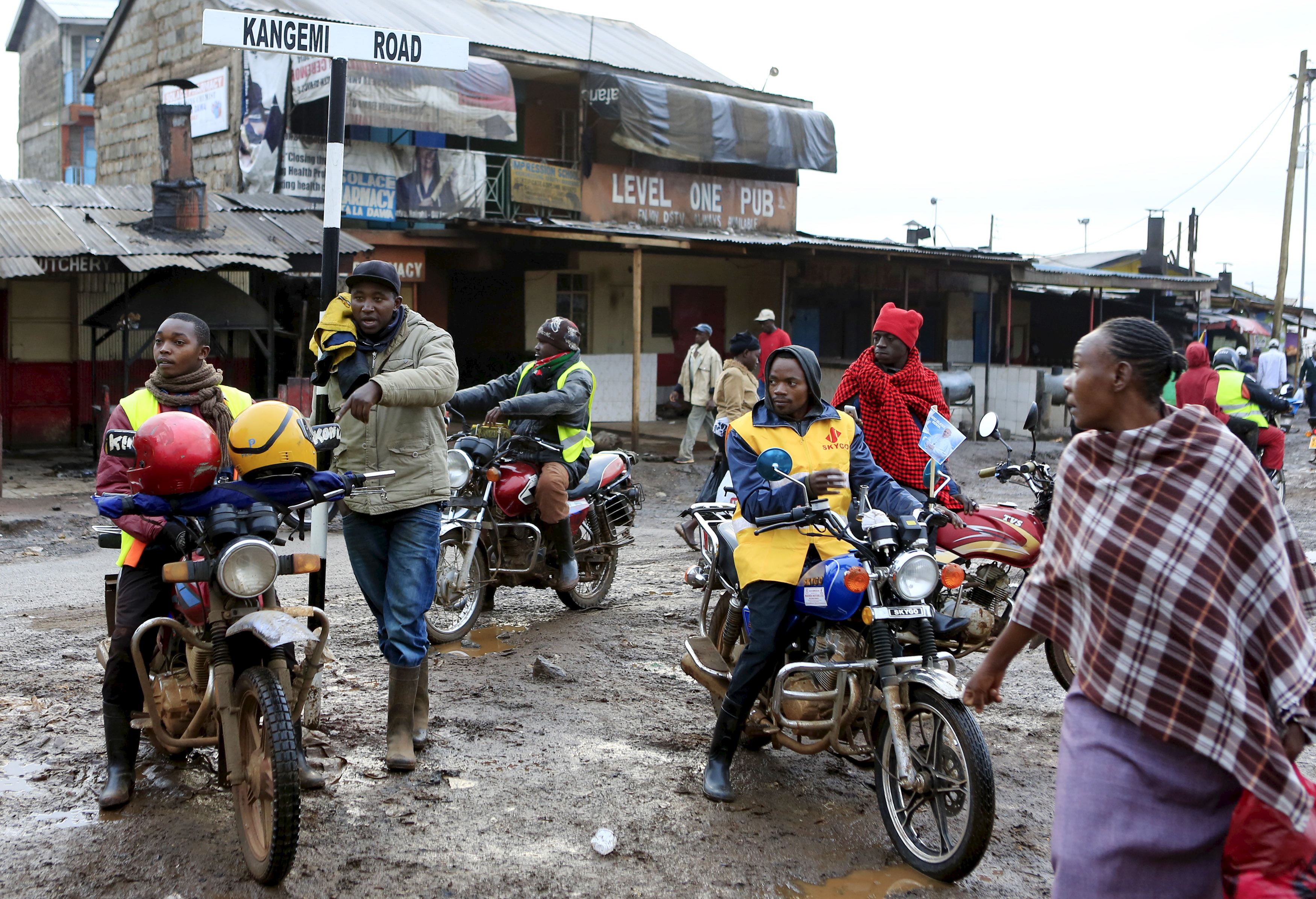 """Motorbike riders, referred to locally as """"boda boda"""" drivers, wait to transport people to the venue where Pope Francis is expected to lead a mass in the Kangemi slums on outskirts of the capital Nairobi, November 27, 2015."""