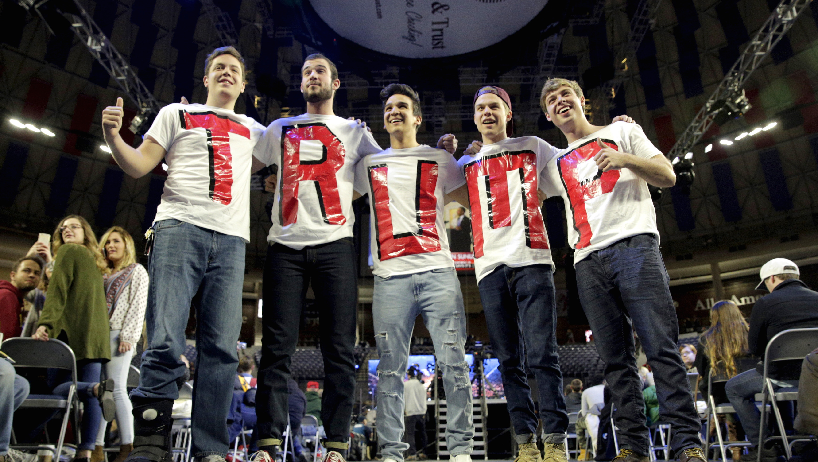 Liberty University students and supporters of Republican presidential candidate Donald Trump wear letters spelling his name before his speech at Liberty University in Lynchburg, Virginia, January 18, 2016.  REUTERS/Joshua Roberts - RTX22XPO
