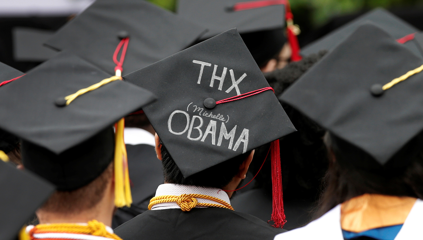 A message is written on the cap of a graduating student as U.S. first lady Michelle Obama (unseen) addresses graduating students of the City College of New York during the College's commencement ceremony in the Harlem section of Manhattan, New York, U.S. June 3, 2016. REUTERS/Mike Segar - RTX2FKIA