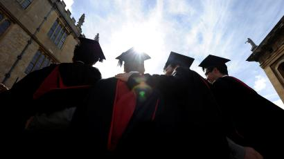 A group of graduates gather outside the Sheldonian Theatre after a graduation ceremony at Oxford University