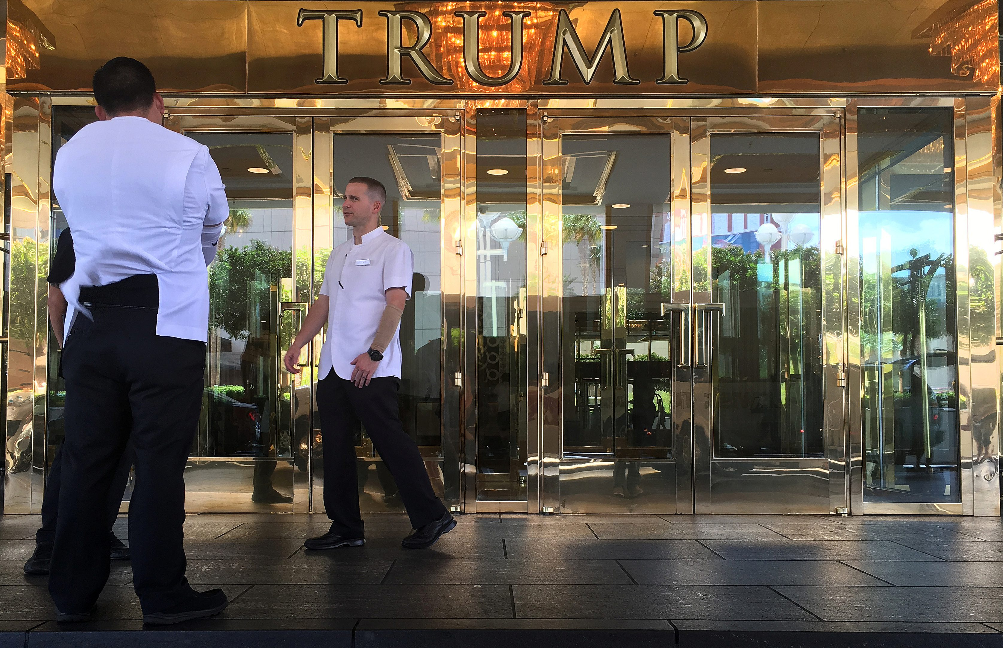 Workers stand outside the Trump Hotel  in Las Vegas