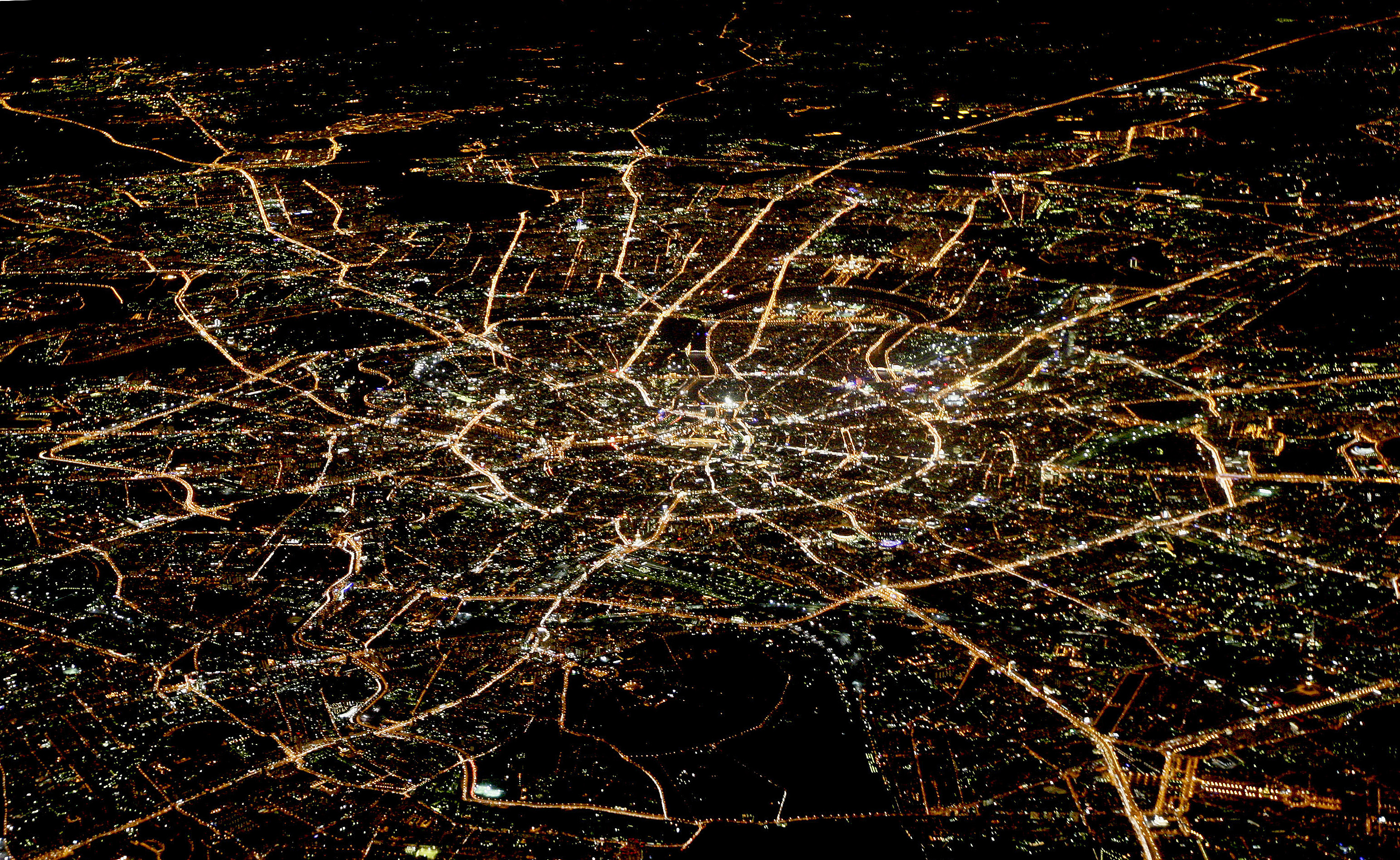A general view of night Moscow is seen from the window of a passenger jet, October 8, 2010.