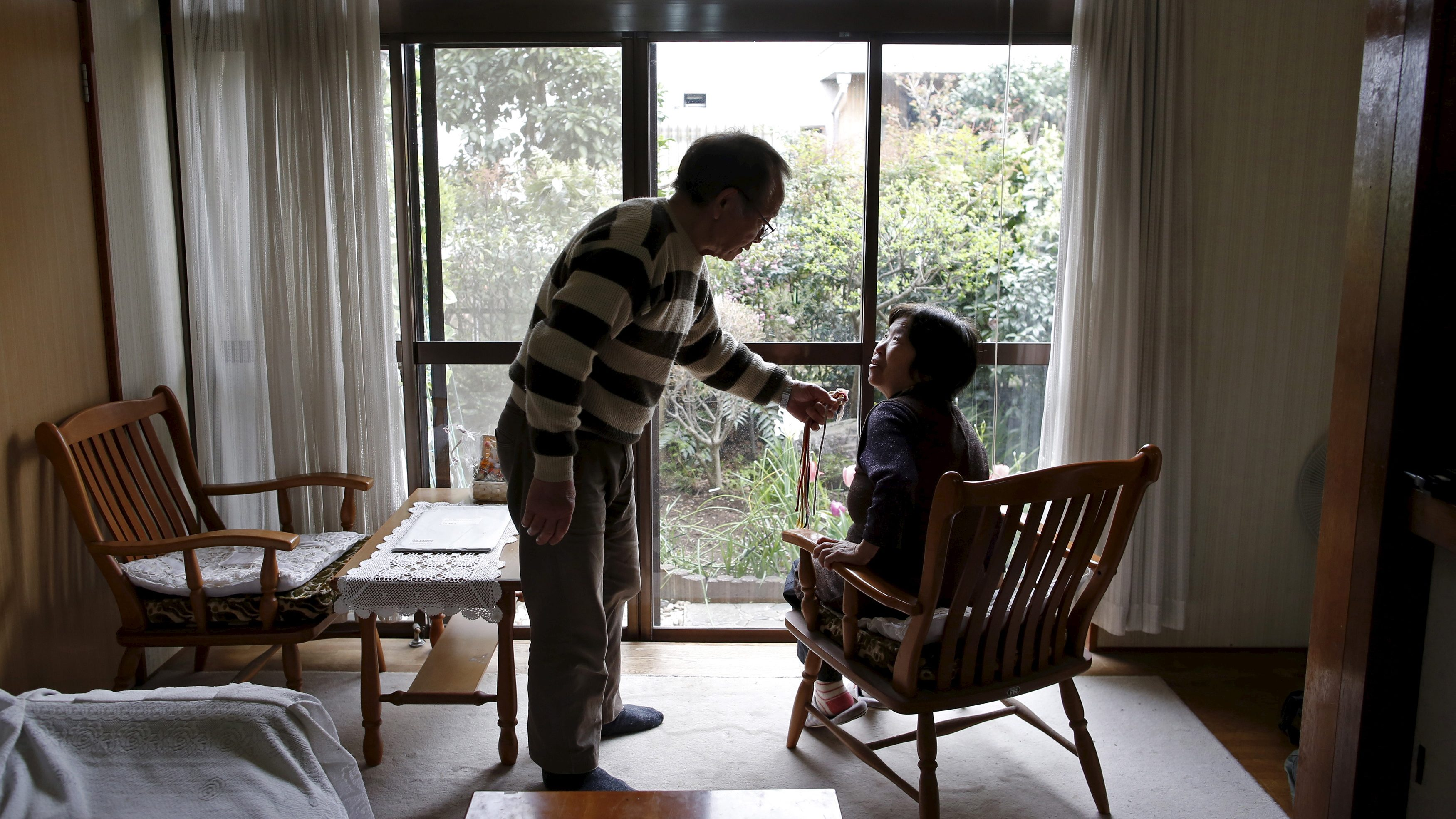 72-year-old Kanemasa Ito (L) and his 68-year-old wife Kimiko who was diagnosed with dementia 11 years ago, chat at their home in Kawasaki, south of Tokyo, Japan, April 6, 2016. Encouraging people with dementia to speak out is part of Japan's effort to ease the negative image of a disorder that affects nearly 5 million citizens and is forecast to affect 7 million, or one in five Japanese age 65 or over, by 2025.