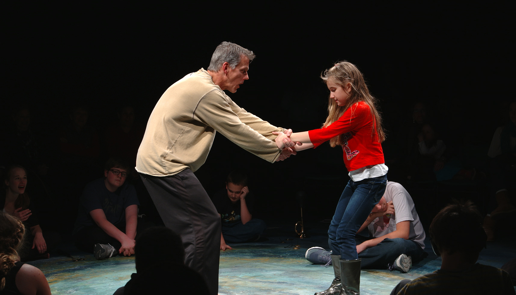 An actor and child with ASD act out a scene from The Tempest