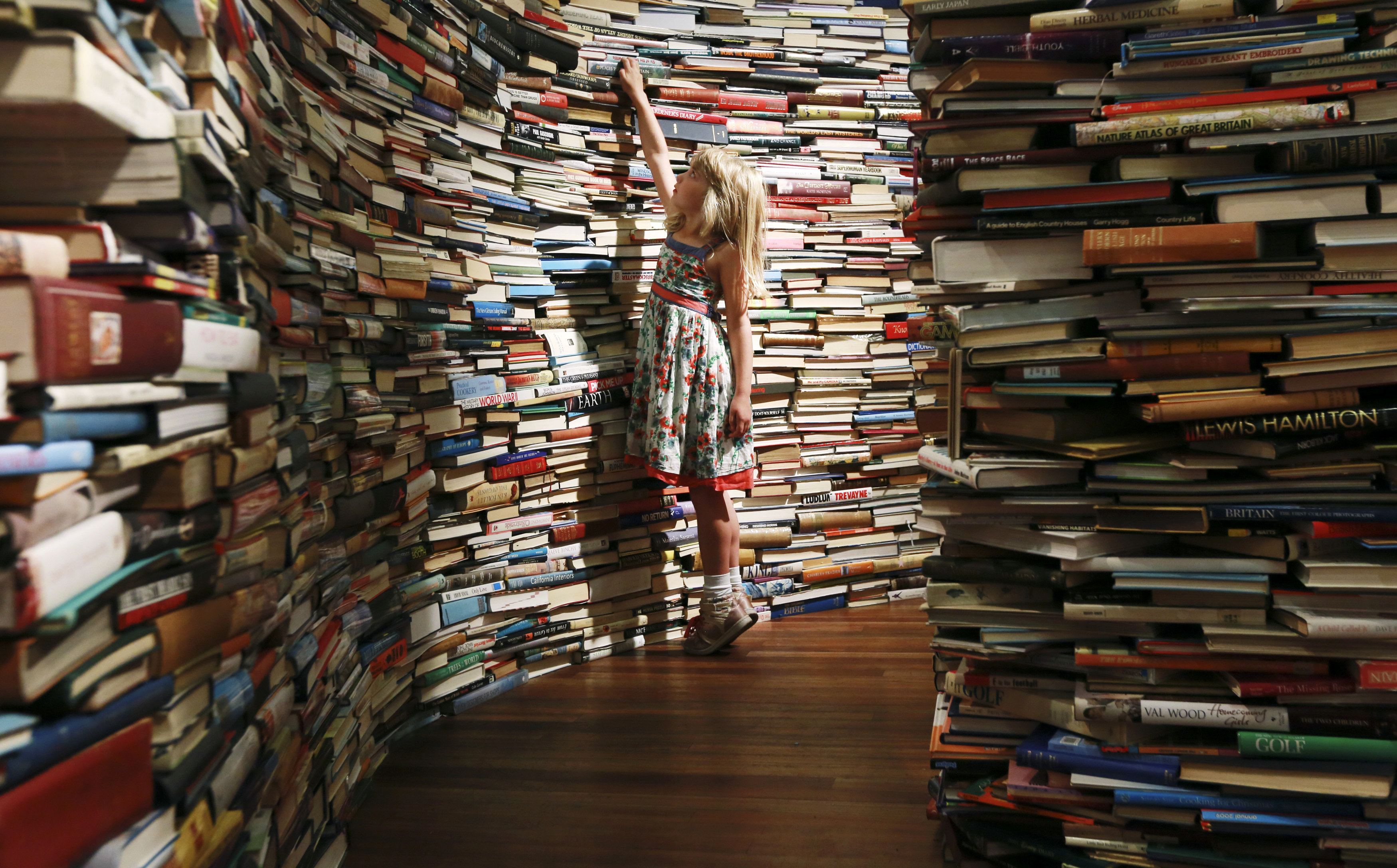 a girl in a labyrinth of books