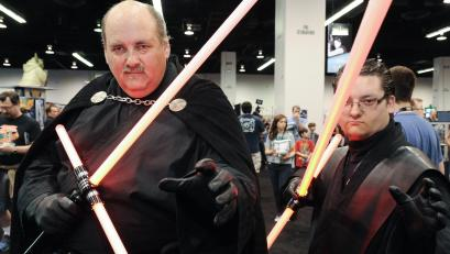 Star Wars fans with lightsabers