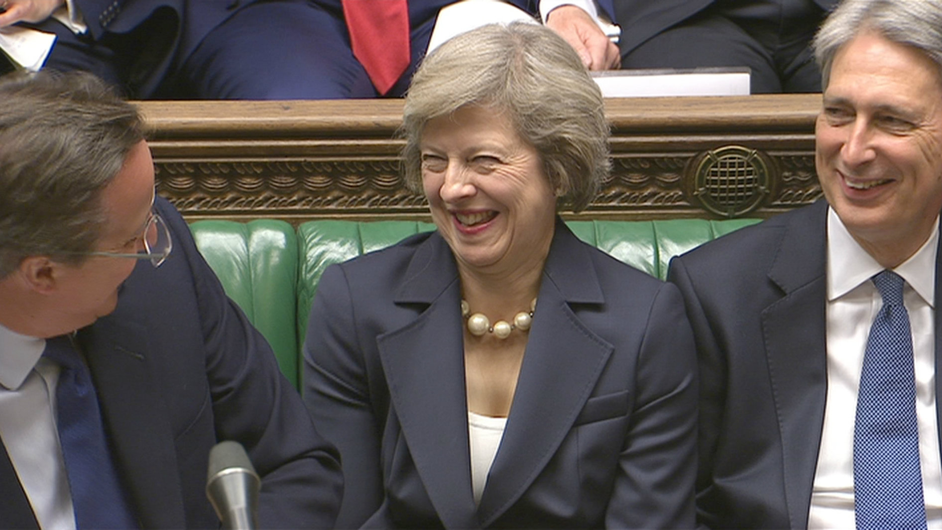 Theresa May laughs with former prime minister David Cameron and Chancellor Philip Hammond
