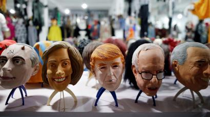 """Masks of different politicians are displayed in the showroom of Jinhua Partytime Latex Art and Crafts Factory in Jinhua, Zhejiang Province, China, May 25, 2016. There's no masking the facts. One Chinese factory is expecting Donald Trump to beat his likely U.S. presidential rival Hilary Clinton in the popularity stakes. At the Jinhua Partytime Latex Art and Crafts Factory, a Halloween and party supply business that produces thousands of rubber and plastic masks of everyone from Osama Bin Laden to Spiderman, masks of Donald Trump and Democratic frontrunner Hillary Clinton faces are being churned out. Sales of the two expected presidential candidates are at about half a million each but the factory management believes Trump will eventually run out the winner. """"Even though the sales are more or less the same, I think in 2016 this mask will completely sell out,"""" said factory manager Jacky Chen, indicating a Trump mask. REUTERS/Aly Song SEARCH """"JINHUA MASK"""" FOR THIS STORY. SEARCH """"THE WIDER IMAGE"""" FOR ALL STORIES. - RTX2EAY6"""