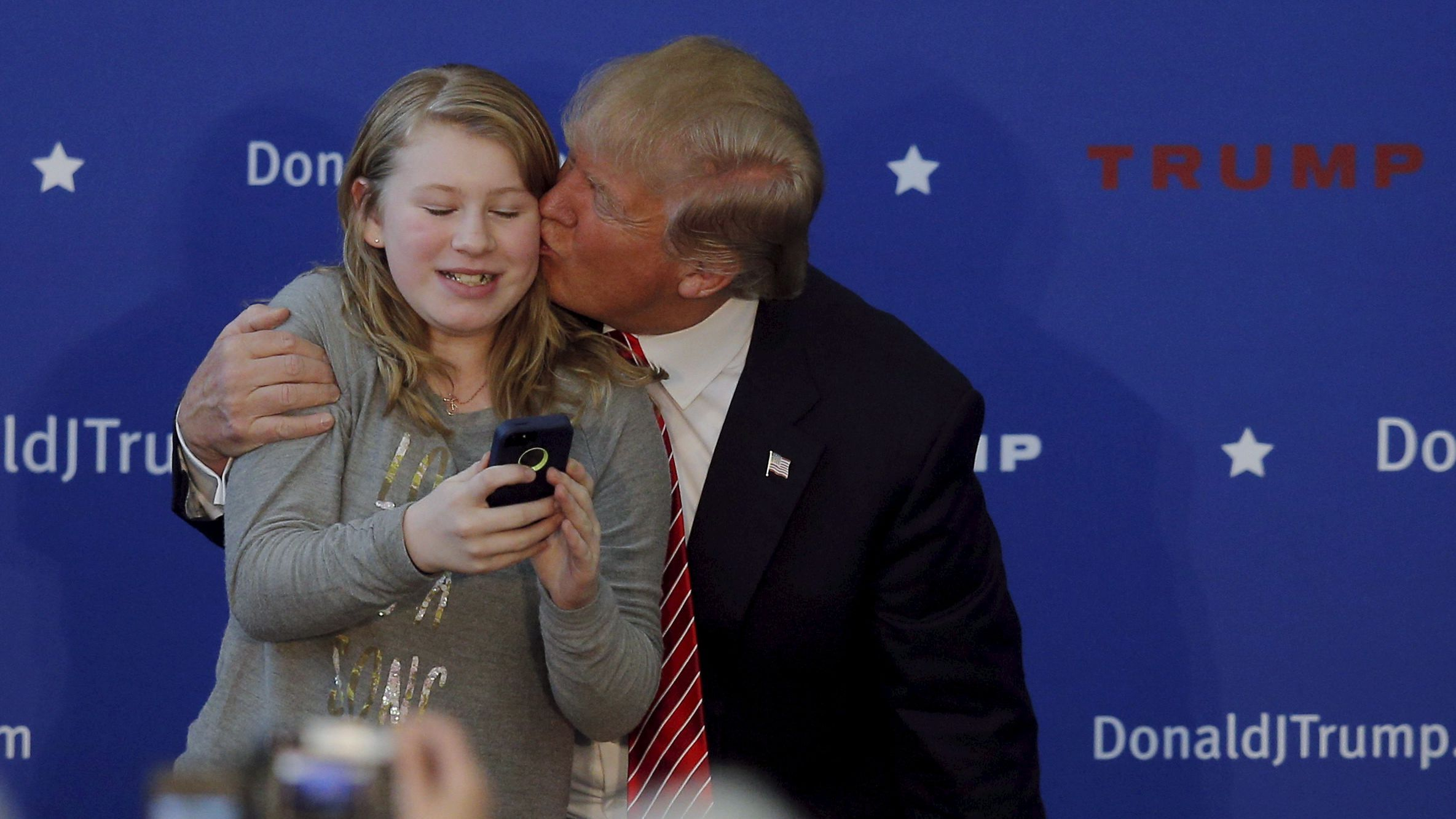donald trump kisses young supporter at rally