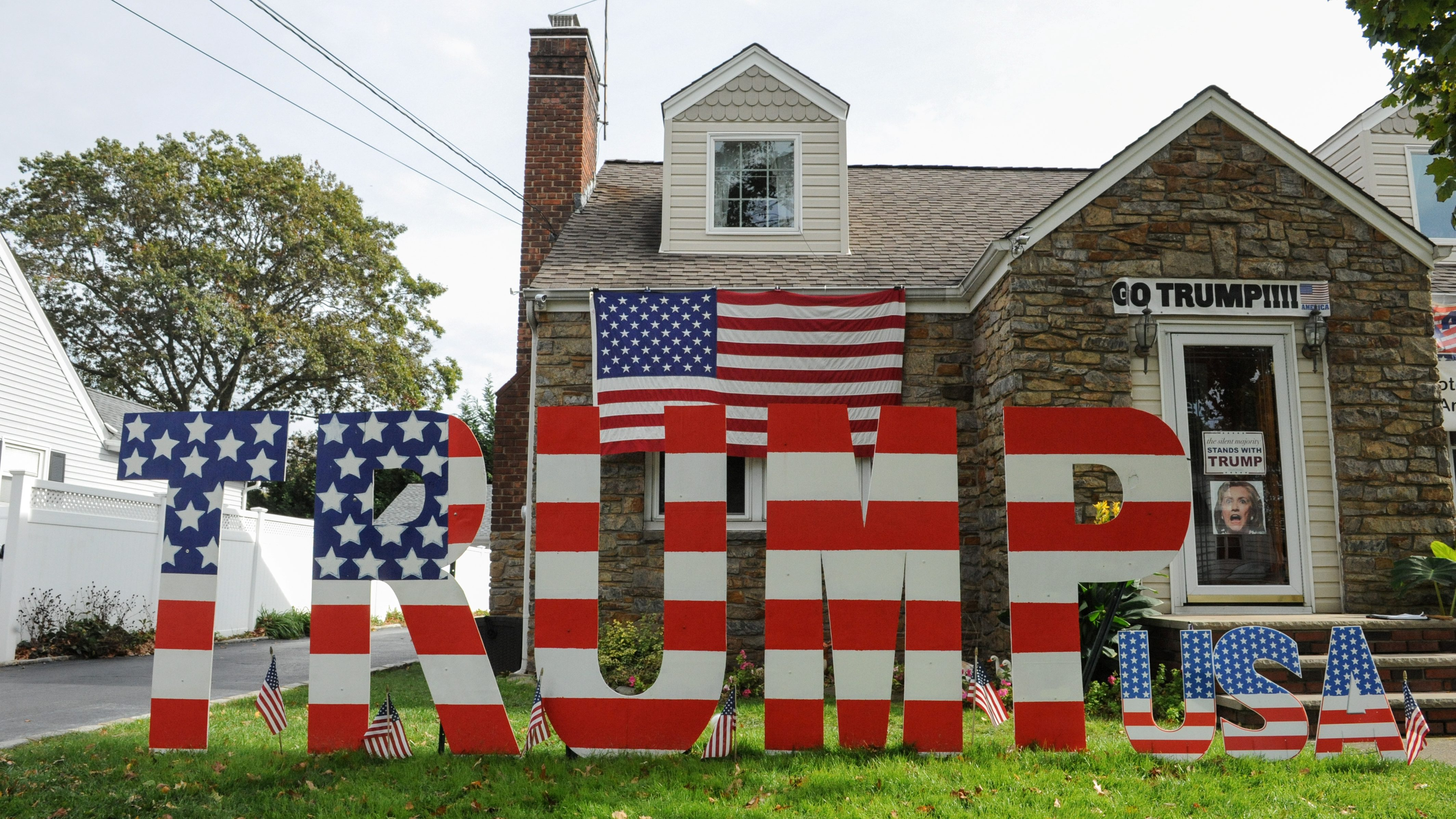 A home displaying signs supporting U.S. Republican Presidential candidate Donald Trump