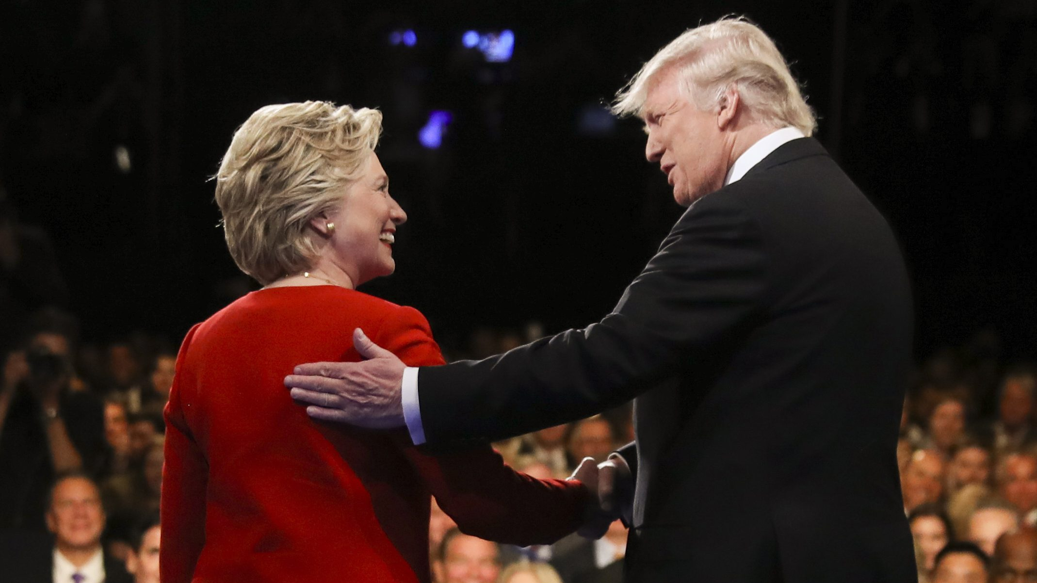 Democratic presidential nominee Hillary Clinton and Republican presidential nominee Donald Trump shake hands during the presidential debate at Hofstra University in Hempstead, N.Y. For presidential candidates, the town hall debate is a test of stagecraft as much as substance. When Hillary Clinton and Donald Trump meet in the Sunday, Oct.9, 2016, contest, they'll be fielding questions from undecided voters seated nearby. In an added dose of unpredictability, the format allows the candidates to move around the stage, putting them in unusually close proximity to each other.