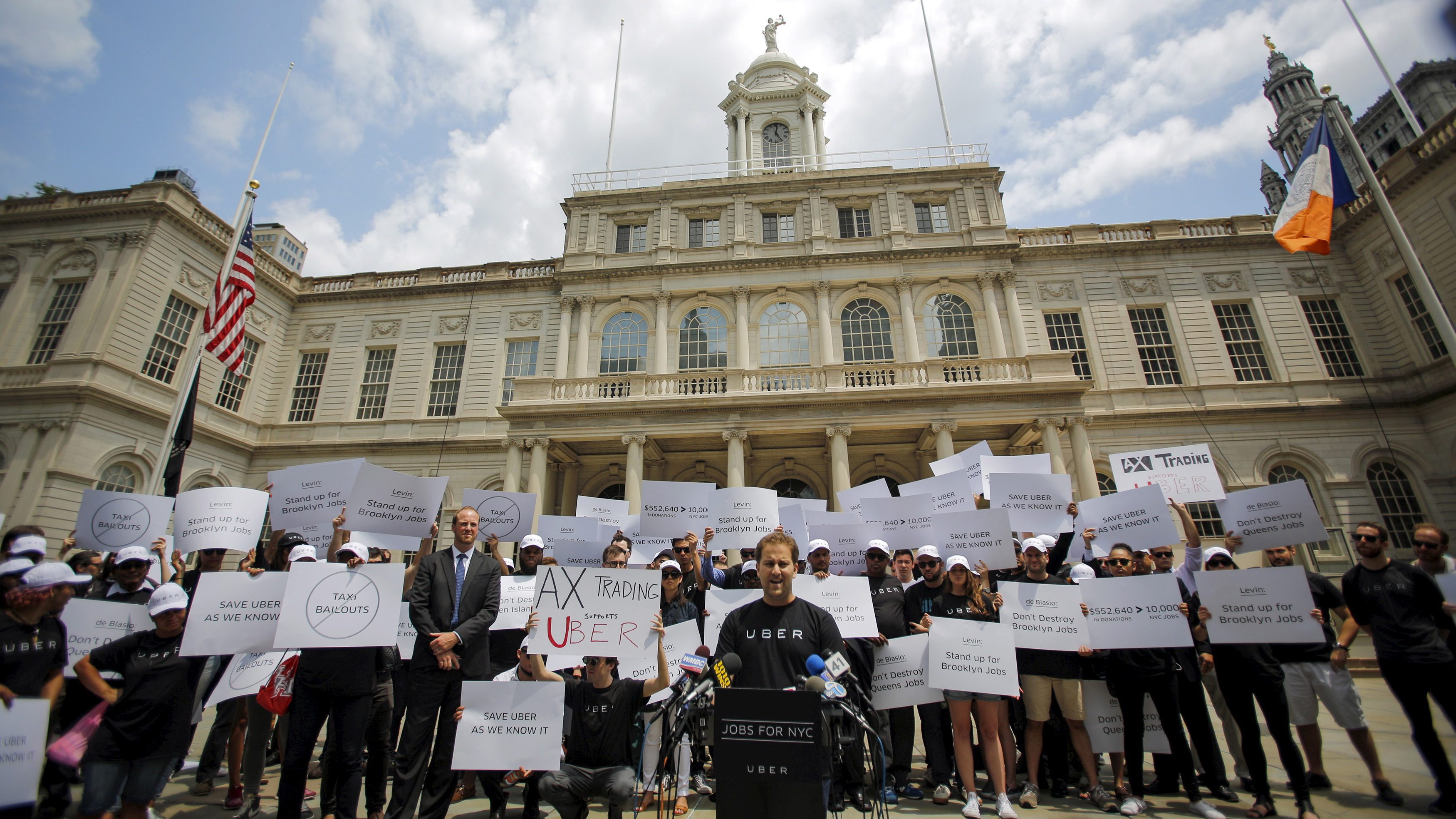 Uber riders and driver-partners take part in a rally on steps of New York City Hall against proposed legislation limiting for-hire vehicles in New York June 30, 2015. REUTERS/Eduardo Munoz - RTX1IHAT
