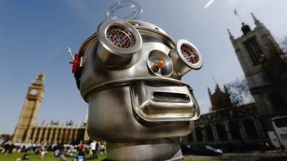 A robot is pictured in front of the Houses of Parliament and Westminster Abbey as part of the Campaign to Stop Killer Robots in London
