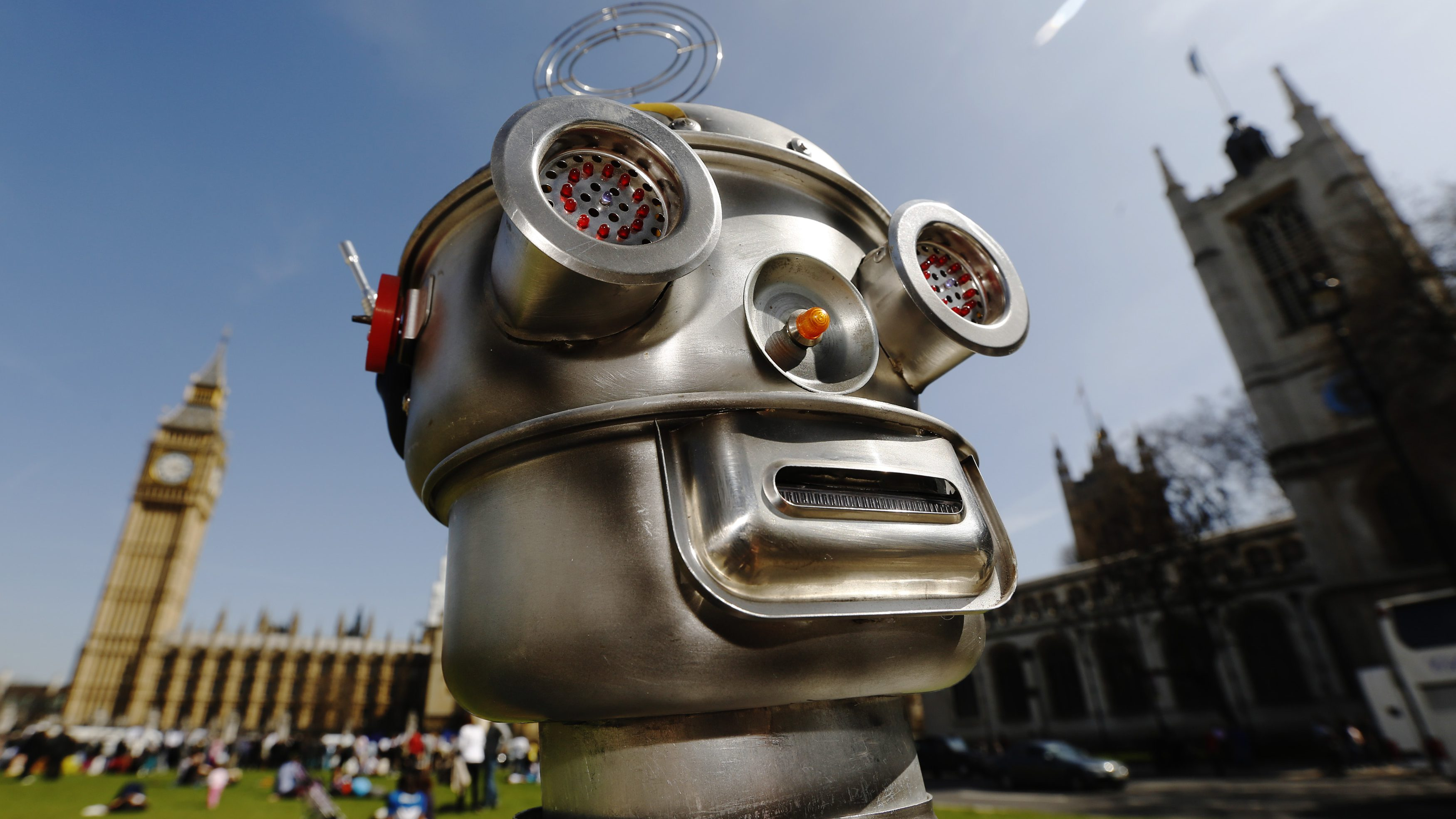 A robot is pictured in front of the Houses of Parliament and Westminster Abbey as part of the Campaign to Stop Killer Robots in London April 23, 2013. Robots with the ability to attack targets without any human intervention must be banned before they are even developed for use in a battlefield, campaigners urged on Tuesday.