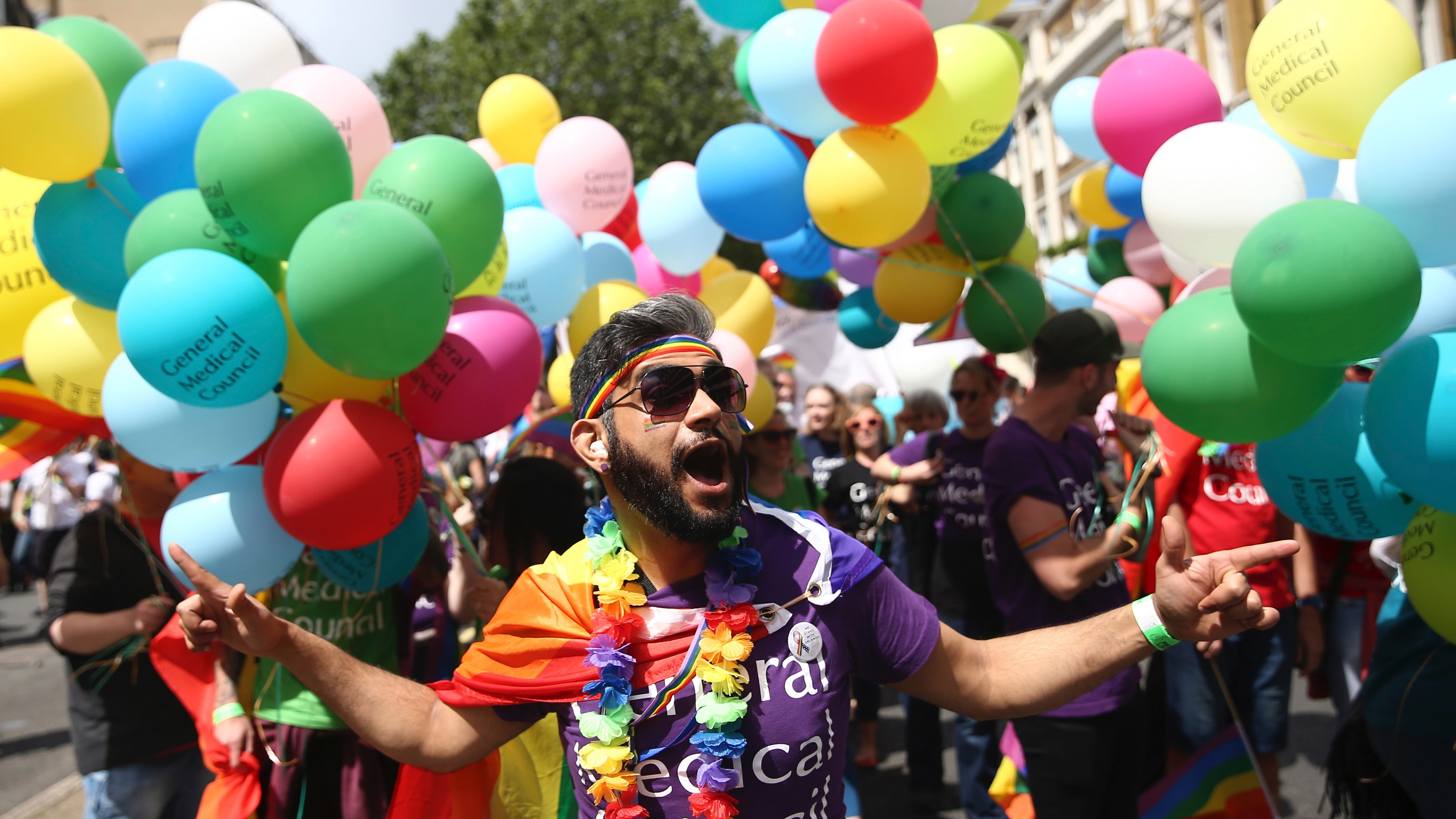 Participants take part in the annual Pride London Parade, in London