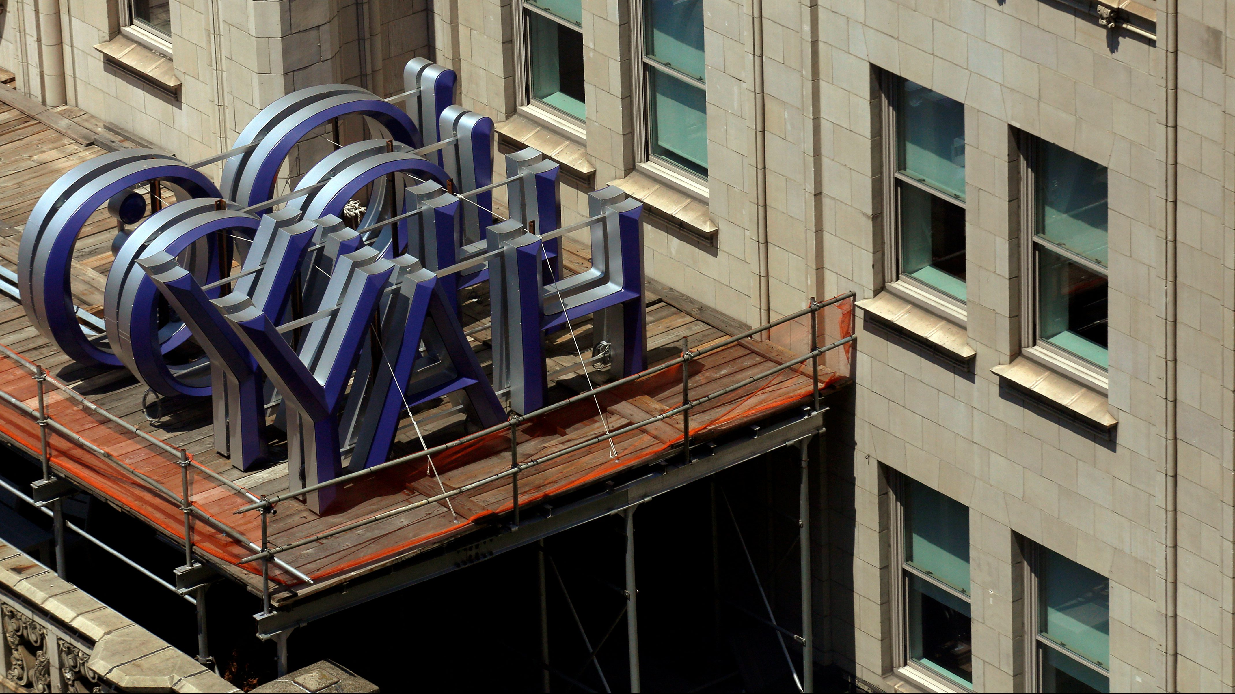 A Yahoo logo is seen on top of the building where they have offices in New York City, U.S., July 25, 2016.