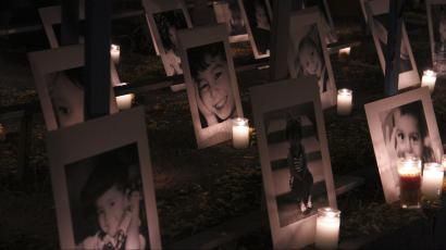 Pictures of victims of a fire at a day-care center are seen during a candlelight vigil in Hermosillo, in the Mexican state of Sonora.