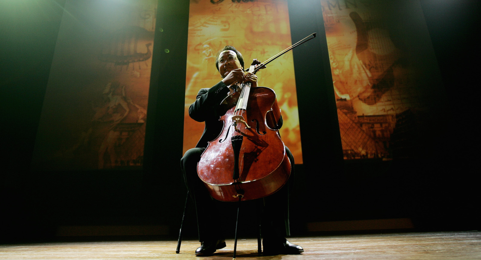 """Cellist Yo-Yo Ma preforms during the Dan David Prize award ceremony in Tel Aviv's University, Israel Sunday, May 21 2006.Word renowned cellist Yo-Yo Ma received a prestigious and valuable prize on Sunday recognizing his """"Silk Road Project"""" for its contribution to international cultural understanding. The Dan David Prize Ma won is worth $1 million. In his acceptance speech, he said he would share it with the musicians, board members and staff of the project. (AP Photo/Ariel Schalit)"""
