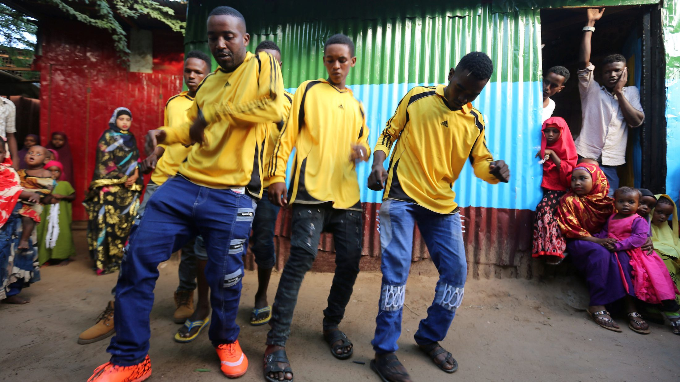 Young boys dance during the wedding ceremony of Somali couple Mohamed Noor and Huda Omar in Mogadishu's Rajo camp, Somalia, August 17, 2016.