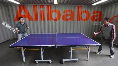 Alibaba employees play table tennis inside the headquarters office of Alibaba (China) Technology Co. Ltd on the outskirts of Hangzhou