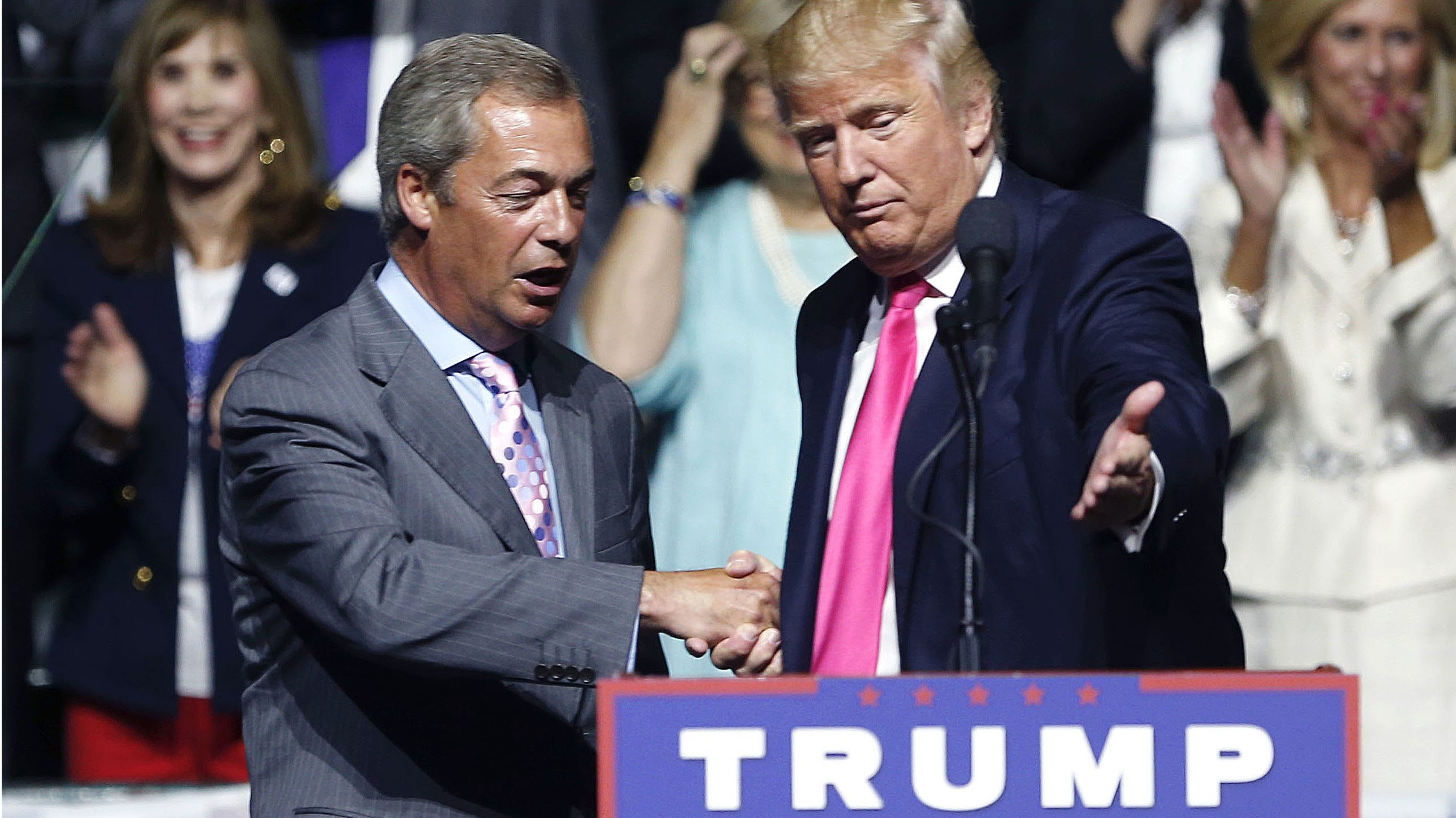 Donald Trump speaks with Nigel Farage.
