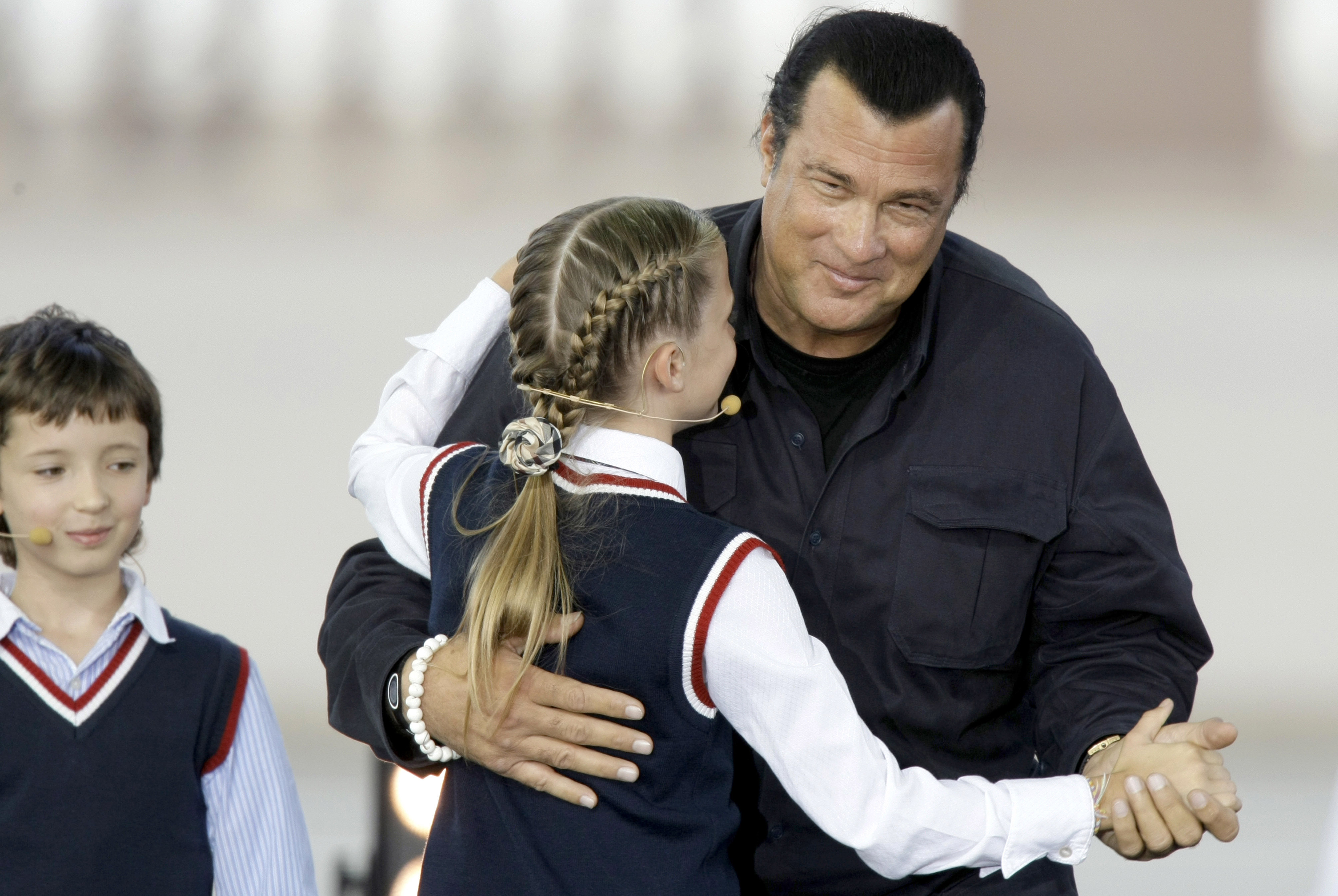 Steven Seagal, a new Russian citizen, dances with a young girl in Moscow