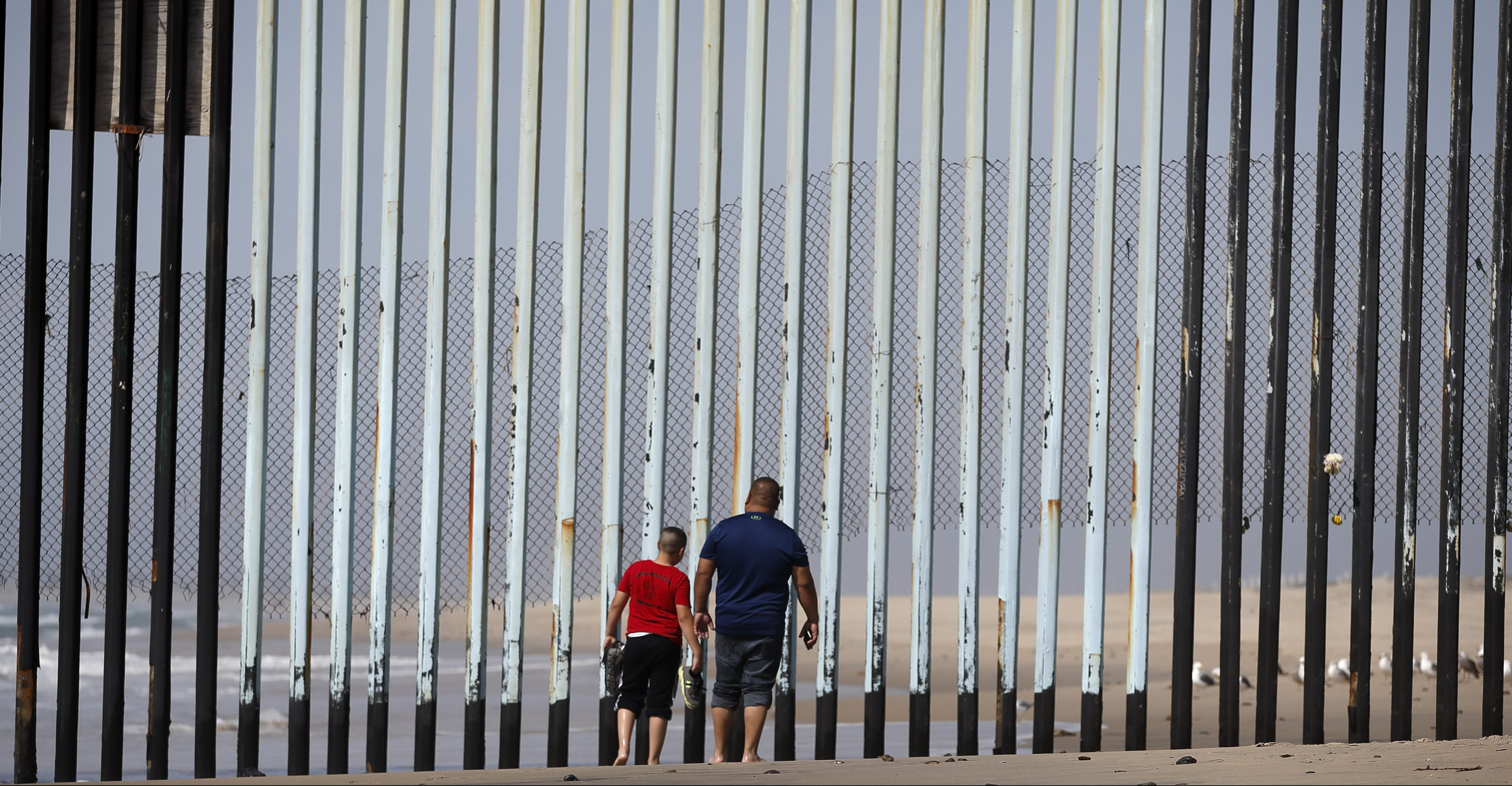 "Two people walk towards metal bars marking the United States border where it meets the Pacific Ocean Wednesday, March 2, 2016, in Tijuana, Mexico. Former Mexican President Vicente Fox on Wednesday stood by his comparison of Donald Trump to Adolf Hitler, saying the Republican presidential front-runner ""believes in the white supremacy."" Fox is calling on Americans to ""wake up"" from ""this Republican nightmare."" He made the remarks Wednesday in an interview taped for Fox News Channel's ""Hannity."" Trump has angered many Mexicans for his campaign rhetoric denigrating some immigrants as ""rapists"" who bring crime and drugs to the United States, and his promise to build a wall along the entire US-Mexico border."