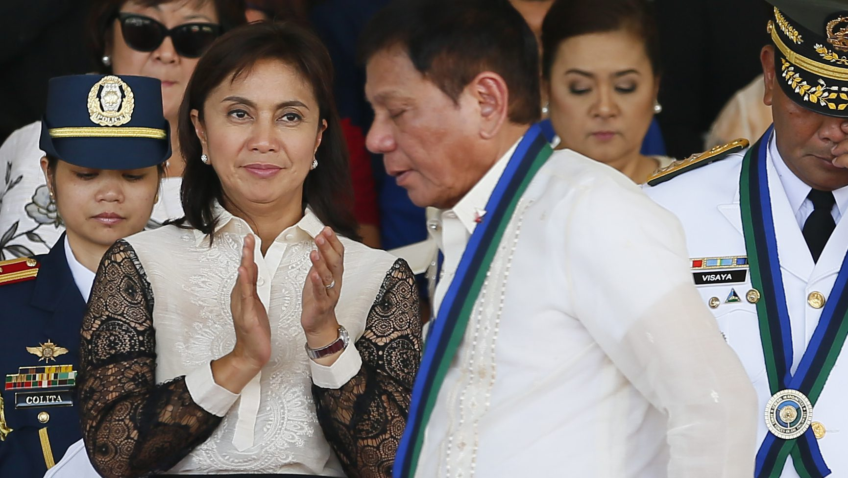 Vice President Leni Robredo applauds as New Philippine President Rodrigo Duterte walks to address the troops during the Change-of-Command ceremony for incoming Armed Forces chief Gen. Ricardo Visaya, right, Friday, July 1, 2016, at Camp Aguinaldo in suburban Quezon city northeast of Manila, Philippines. It was the first meeting between Duterte and Robredo following their separate inaugurals. (Vice President Leni Robredo applauds as New Philippine President Rodrigo Duterte walks to address the troops during the Change-of-Command ceremony for incoming Armed Forces chief Gen. Ricardo Visaya, right, Friday, July 1, 2016, at Camp Aguinaldo in suburban Quezon city northeast of Manila, Philippines. It was the first meeting between Duterte and Robredo following their separate inaugurals. (AP Photo/Bullit Marquez))
