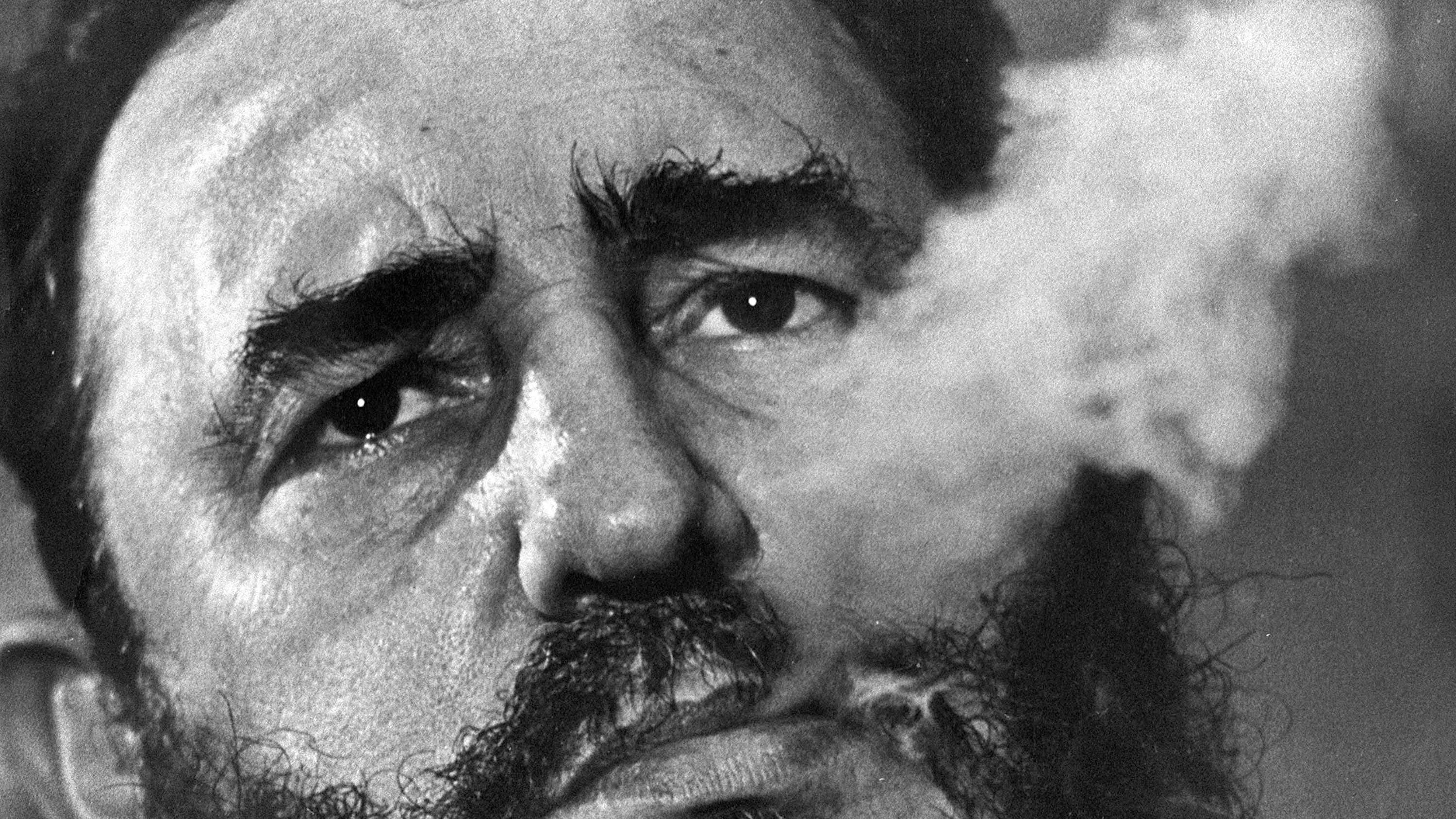 FILE - In this March 1985 file photo, Cuban Prime Minister Fidel Castro exhales cigar smoke during an interview at his presidential palace in Havana, Cuba. Castro, a Havana attorney who fought for the poor, overthrew dictator Fulgencio Batista's government on Jan. 1, 1959. As Castro turns 90 on Aug. 13, 2016, it's an uncertain time, with no settled consensus around his legacy. The government and its backers laud Castro's nationalism and his construction of a social safety net that provided free housing, education and health care to every Cuban. Less is said about decades of economic stewardship that, along with a U.S. trade embargo, has left Cuba's infrastructure and its economy cash-strapped and still dependent on billions in aid from abroad.