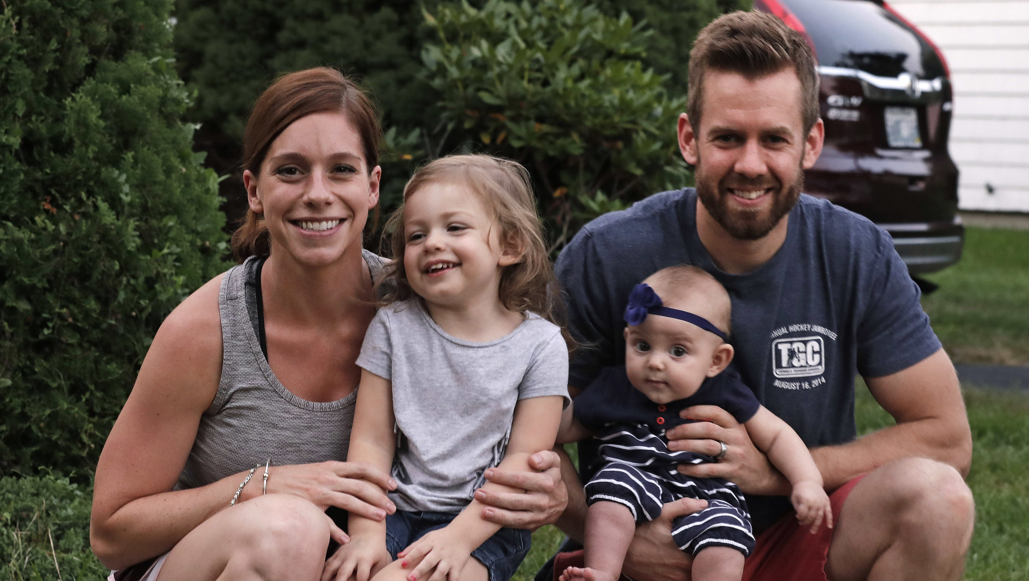 Ryan Smith, right, poses with his wife, Sarah, and children Ashton, 2, and Eden, 6 months, outside their family home, Tuesday, Sept. 20, 2016, in Cranston, Rhode Island. Both of the Smiths were able to take advantage of paid family leave with the birth of their daughter Eden. As both leading presidential candidates tout campaign proposals promising paid leave to take care of a newborn baby, three states, California, New Jersey and Rhode Island, already have programs available to parents.