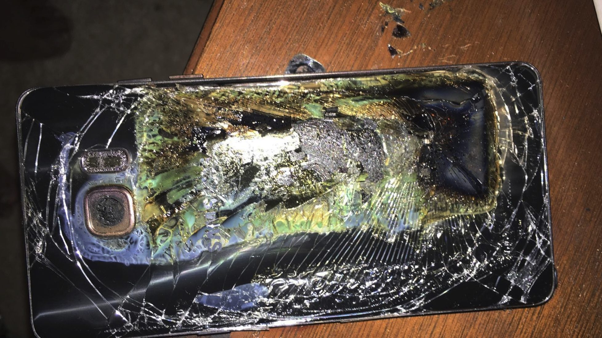This Sunday, Oct. 9, 2016, photo shows a damaged Samsung Galaxy Note 7 on a table in Richmond, Va., after it caught fire earlier in the day. Samsung Electronics said Tuesday, Oct. 11, that it is discontinuing production of Galaxy Note 7 smartphones permanently, a day after stopping global sales of the ill-fated devices. (Shawn L. Minter via AP)