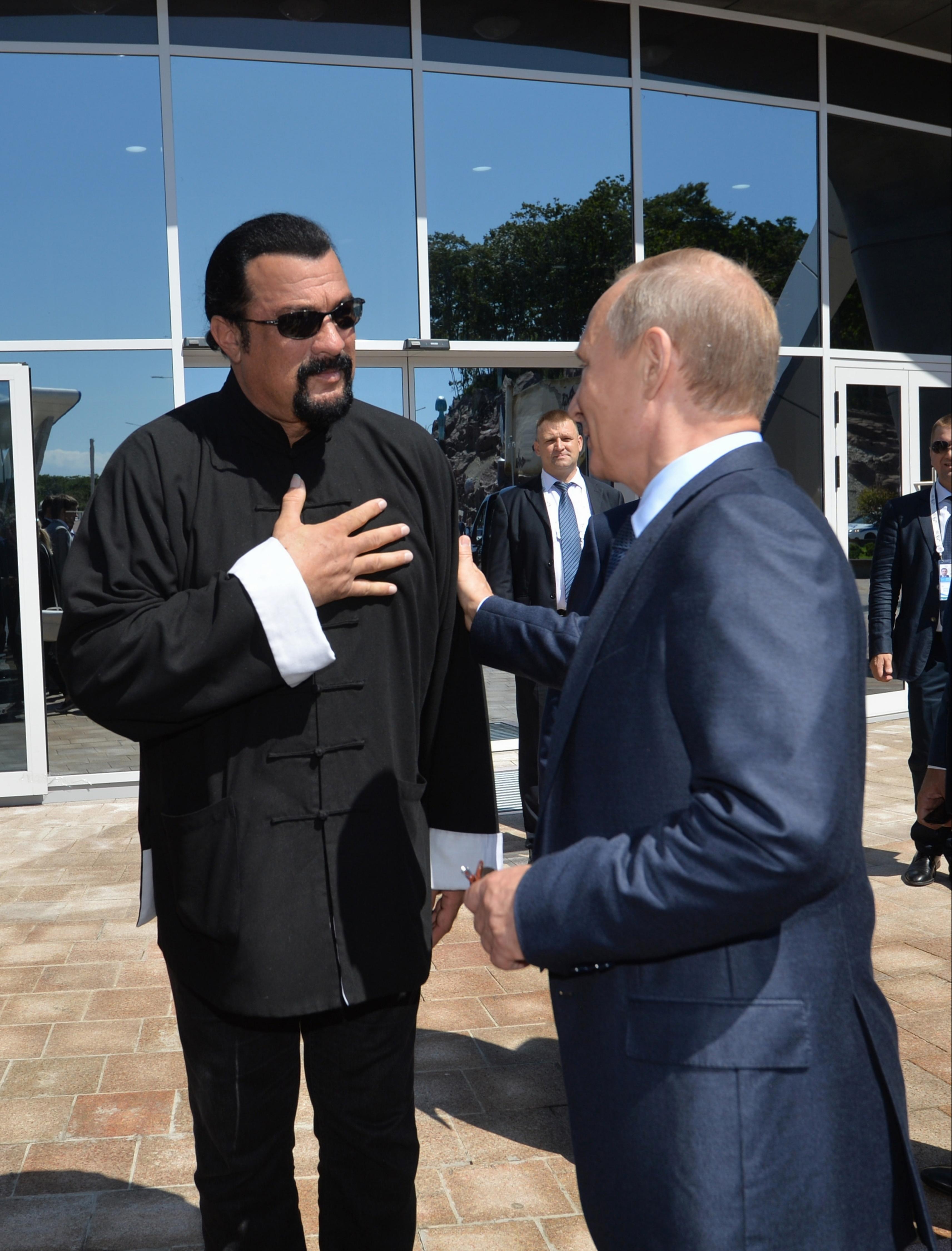 Steven Seagal and Vladimir Putin share a warm moment