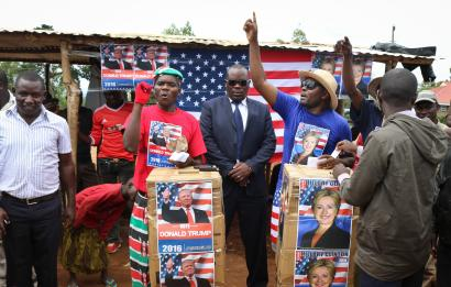"""Comedians stage a mock election in the village of Kogelo, the home town of Sarah Obama, step-grandmother of President Barack Obama, in western Kenya, Tuesday, Nov. 8, 2016. Residents of the town made famous by its association with President Obama cast their """"votes"""" for either Hillary Clinton or Donald Trump, with Clinton winning according to an organizer."""