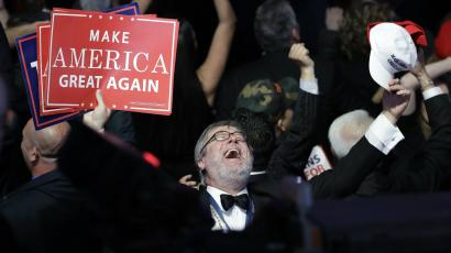 Supporters of Republican presidential candidate Donald Trump react as they watch the election results during Trump's election night rally, Tuesday, Nov. 8, 2016, in New York.