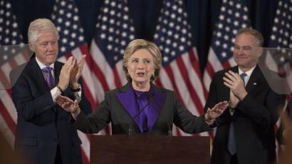 Former President Bill Clinton and Sen. Tim Kaine, D-Va. applaud as Democratic presidential candidate Hillary Clinton speaks in New York, Wednesday, Nov. 9, 2016, where she conceded her defeat to Republican Donald Trump after the hard-fought presidential election. (AP Photo/Matt Rourke)