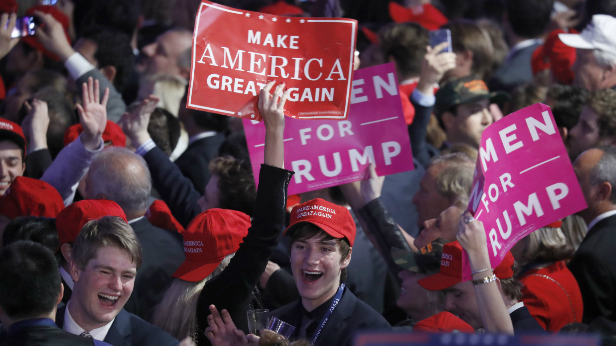 Supporters cheer as they wait for President-elect Donald Trump to give his acceptance speech during his election night rally, Wednesday, Nov. 9, 2016, in New York.