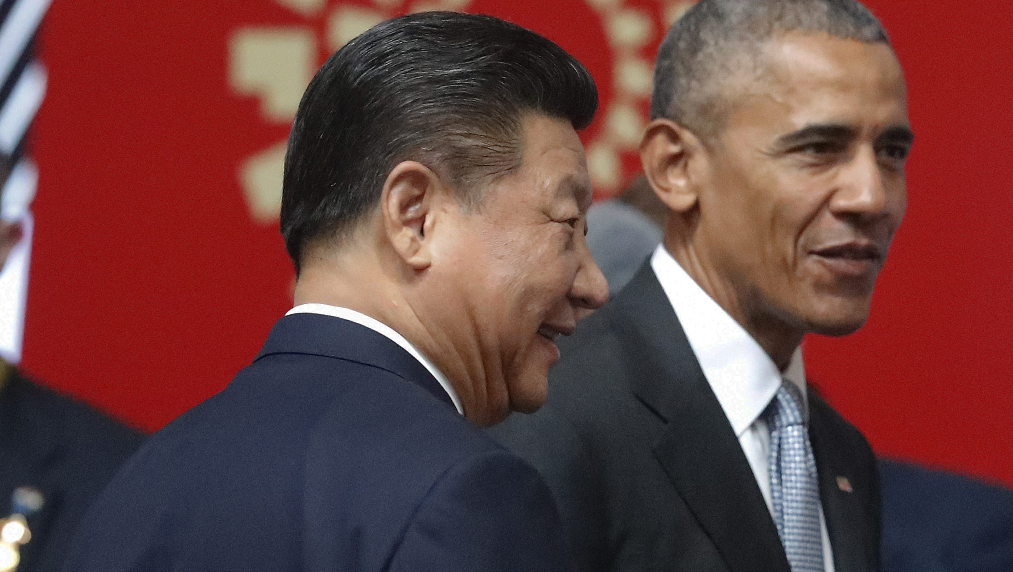U.S. President Barack Obama, right, and China's President Xi Jinping, left, at the opening session of the Asia-Pacific Economic Cooperation (APEC) in Lima, Peru, Sunday, Nov. 20, 2016. (AP Photo/Pablo Martinez Monsivais)