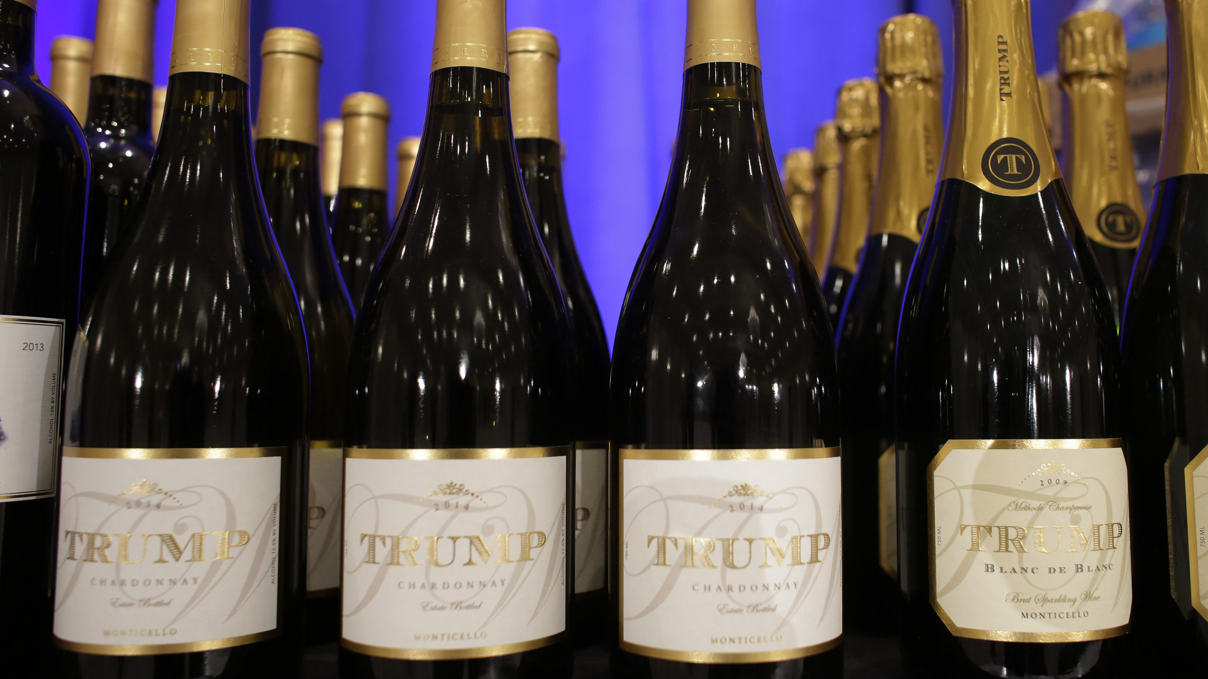 Trump branded wine is displayed prior to a scheduled news conference by Republican presidential candidate Donald Trump, Tuesday, March 8, 2016, in Jupiter, Fla. Trump branded steaks, wine, and water were on display next to the stage at the Trump National Golf Club. (AP Photo/Lynne Sladky)