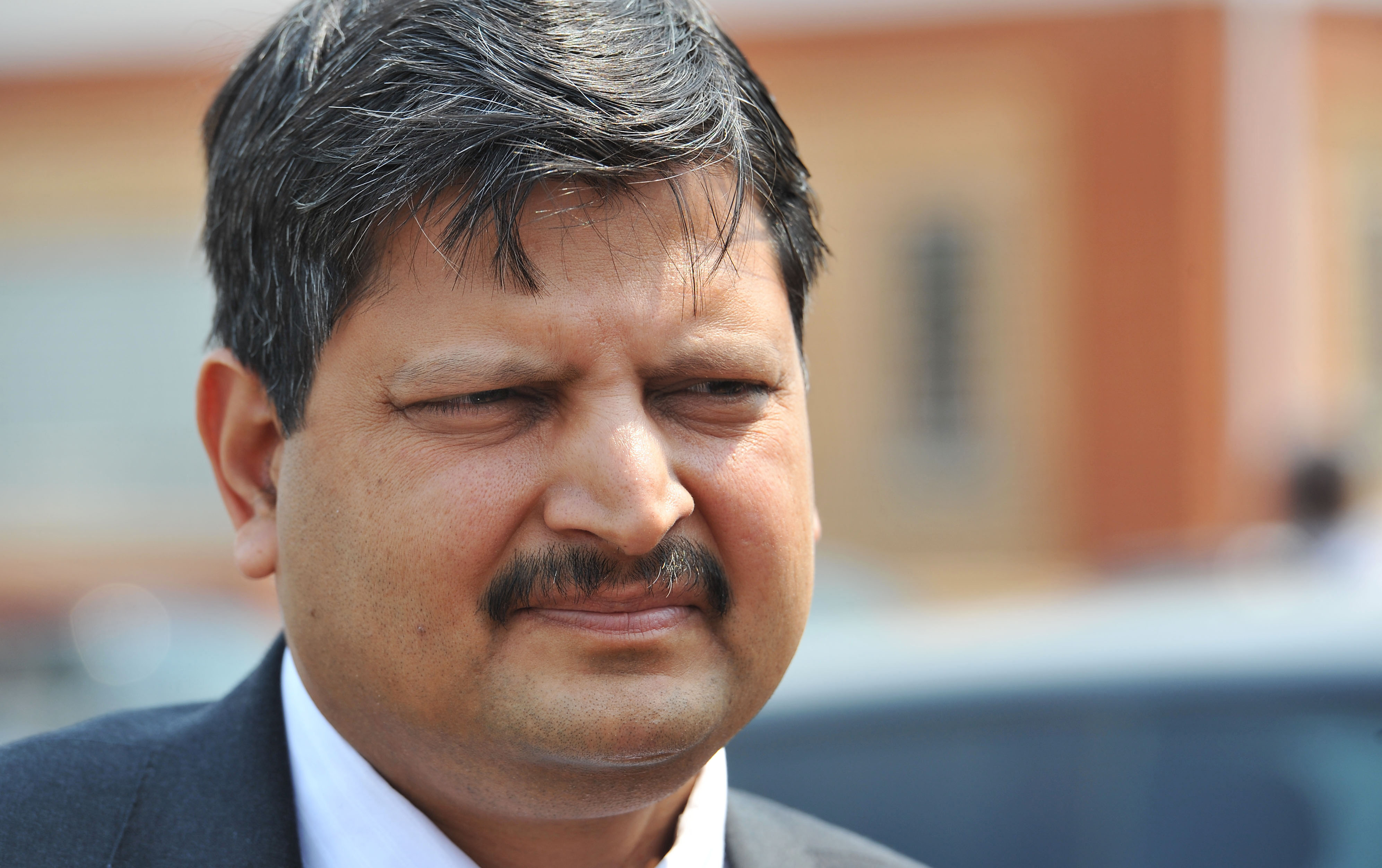 In this photo taken in September 2010 Atul Gupta is seen outside magistrates courts in Johannesburg. The wealthy Gupta family has been criticized or allegedly improper links to president Jacob Zuma. The Gupta family denies that it is corrupt but does not directly address accusations that it tried to boost business by influencing some of Zuma's choices for Cabinet posts, even allegedly offering the finance minister's job to an official. (AP Photo) SOUTH AFRICA OUT
