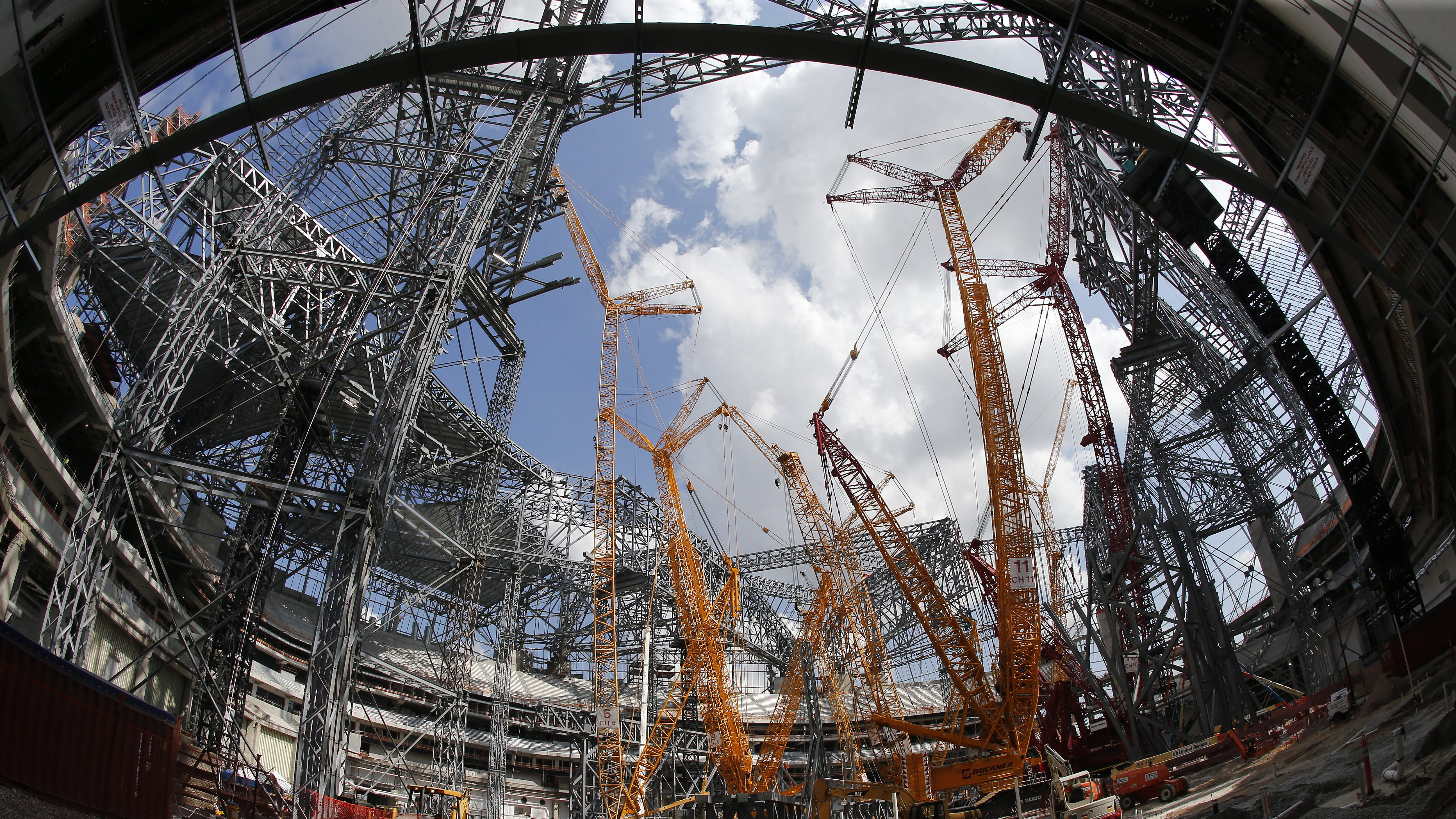 Giant cranes tower over  the Mercedes-Benz Stadium as construction progresses in Atlanta, Thursday, Sept. 1, 2016. The Falcons plan to open the new stadium in time for next season.