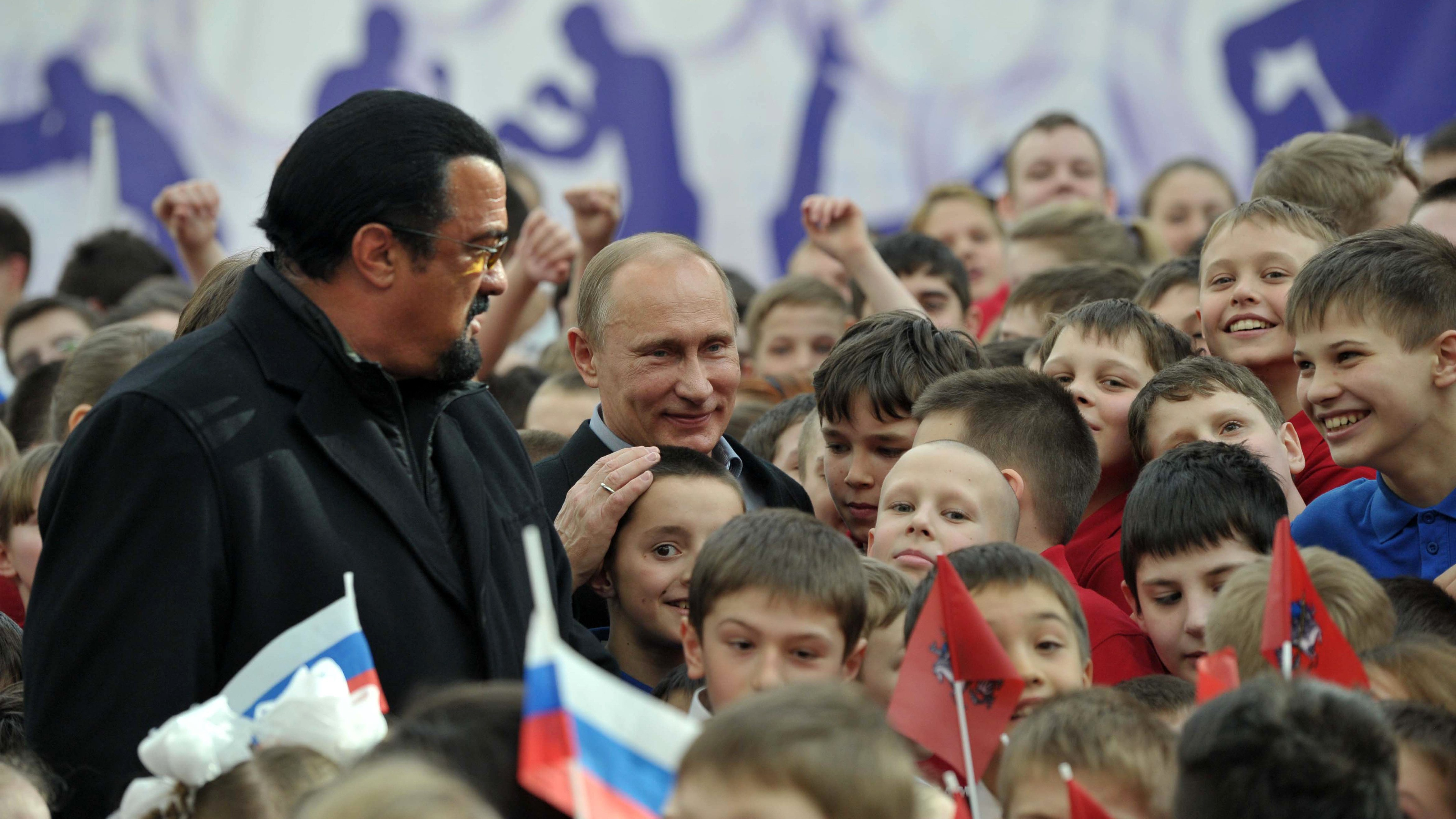 Steven Seagal and Vladimir Putin greet adoring crowds in Moscow